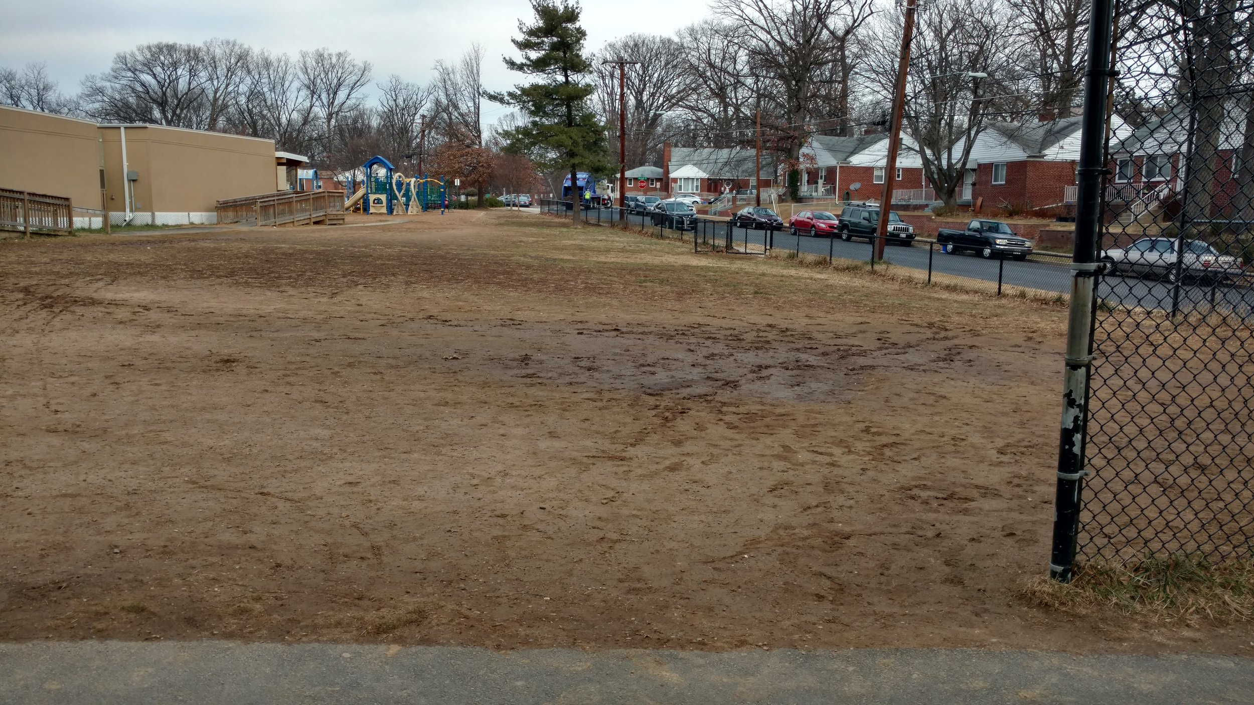 Rolling Terrace's field in December 2016. Students' families and teachers, led by the Rolling Terrace PTA,convinced Montgomery County leaders to fund field renovations at our school and others with run-down outdoor play areas.