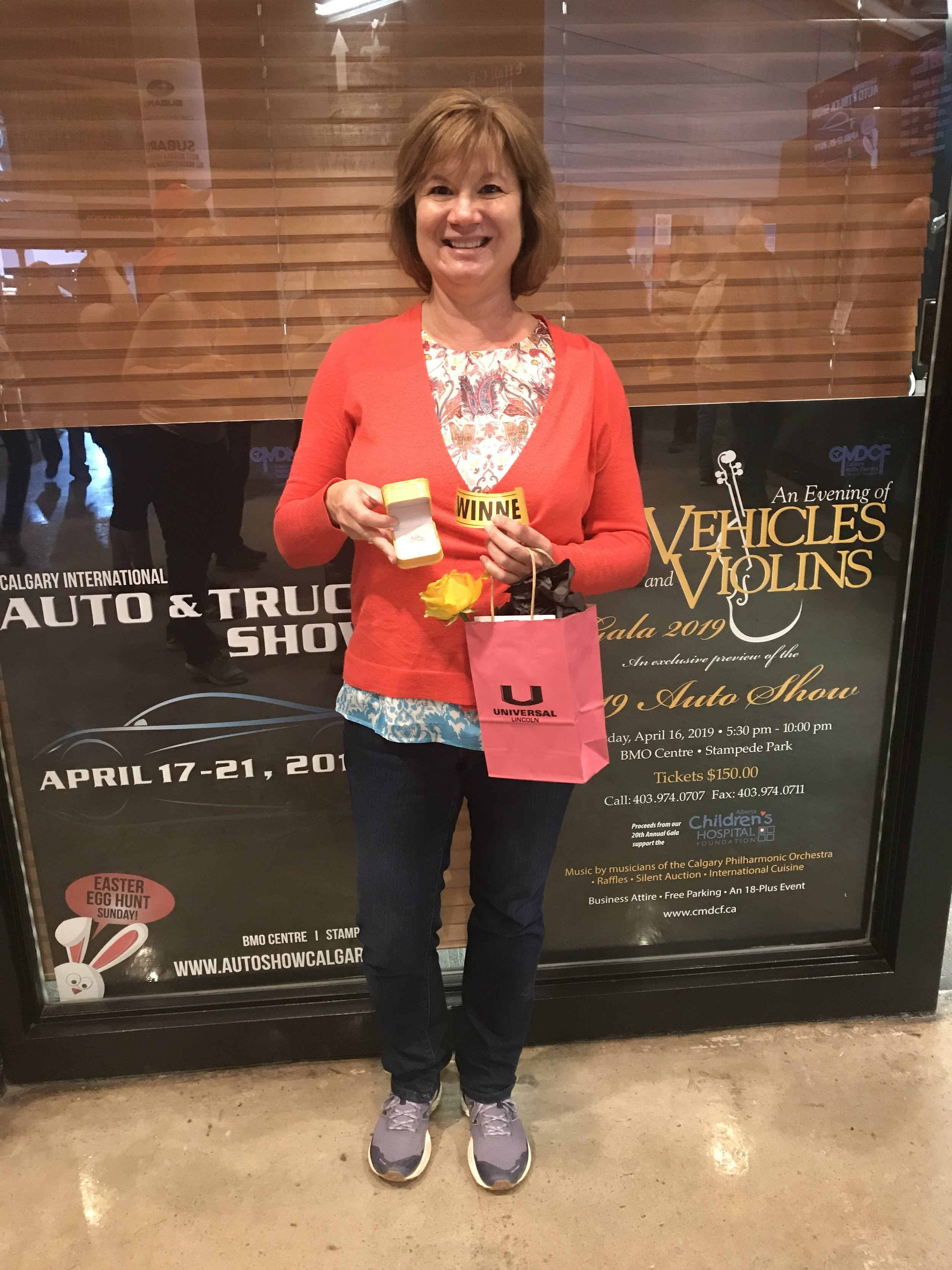 This lucky lady won a diamond ring from Calgary Jewellery. Congrats!