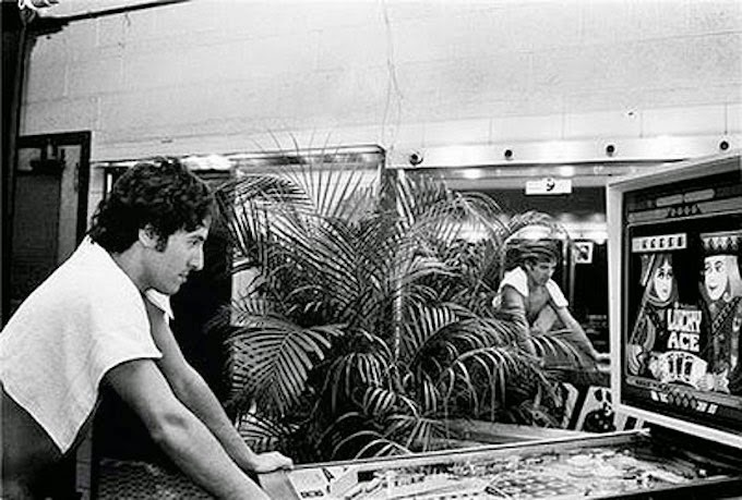 bruce-springsteen-playing-pinball-1970s.jpg