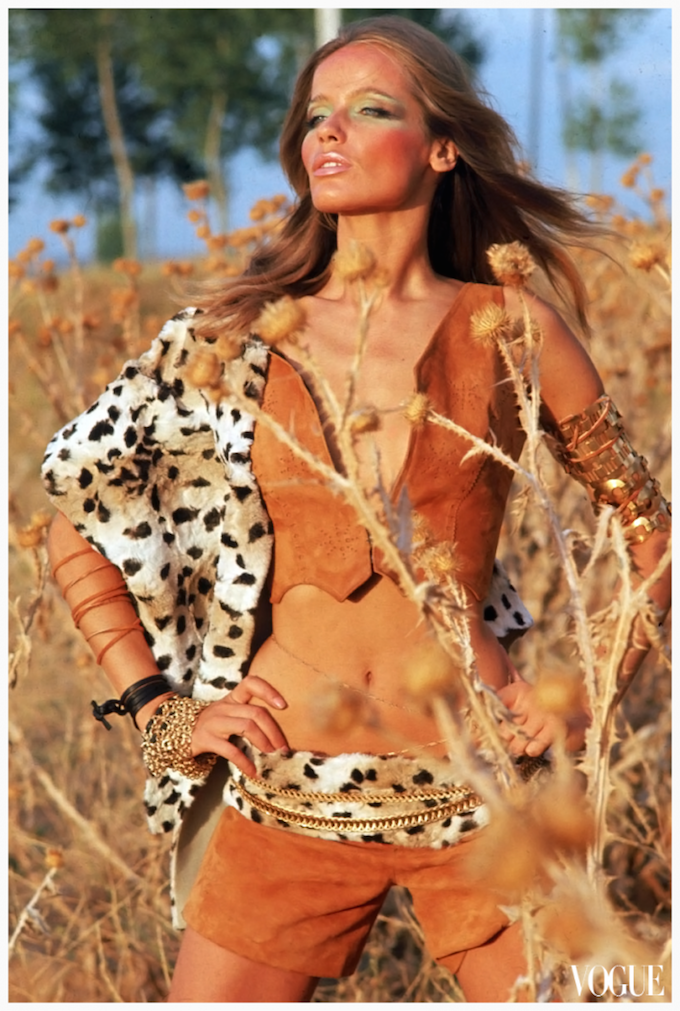 veruschka-standing-in-a-wheat-field-wearing-huge-sparkling-necklace-of-blue-green-and-yellow-rhinestones-on-a-fretwork-of-golden-leaves-circa-february-1966-franco-rubartelli-689x1024.png