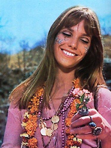 Jane Birkin with lovely flower face paint.