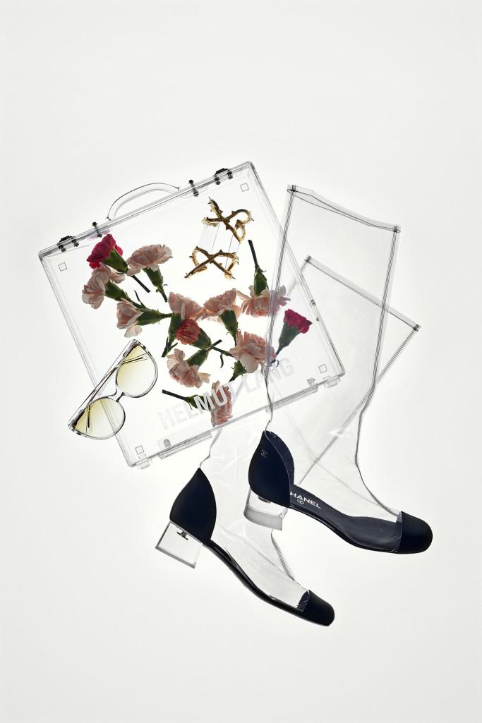 Helmut Lang briefcase, Chanel boots, Balmain cuff and Linda Farrow sunglasses ( Photo Joshua Scott / WWD)
