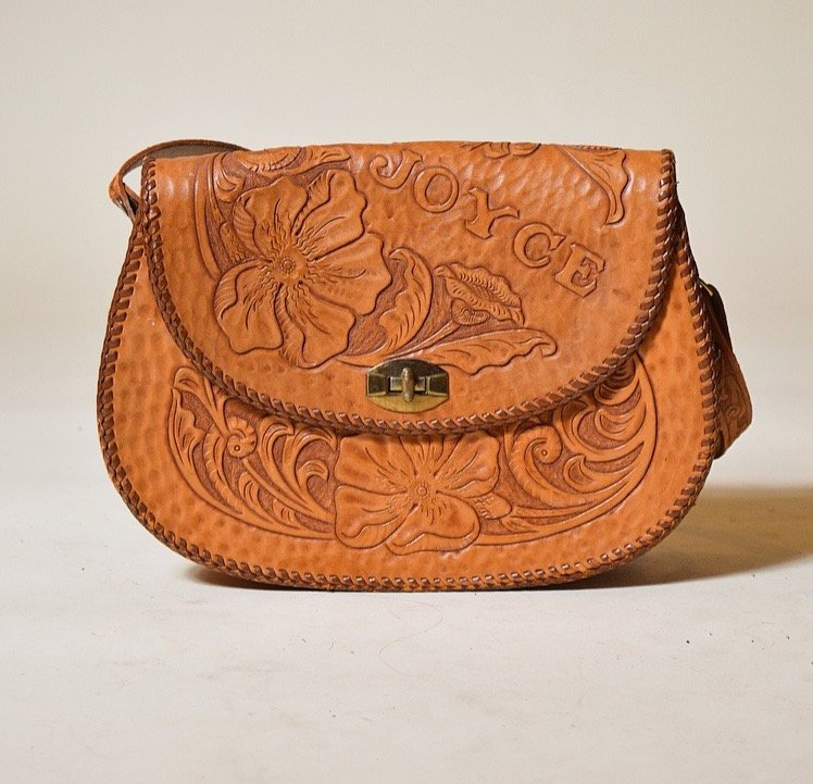 A  vintage leather bag  with a name embossed onto it