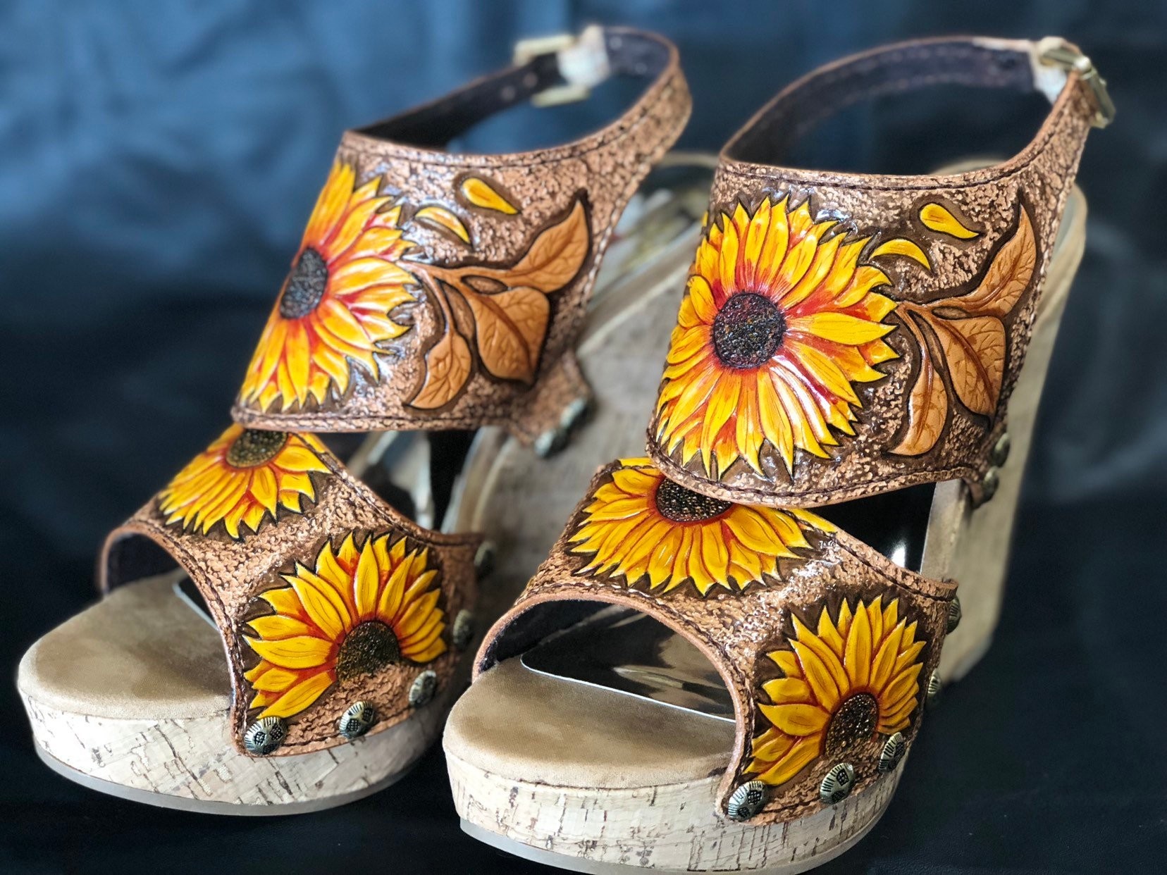 Tooled leather can also be painted or coloured in, like these one of a kind tooled leather  sunflower platform shoes