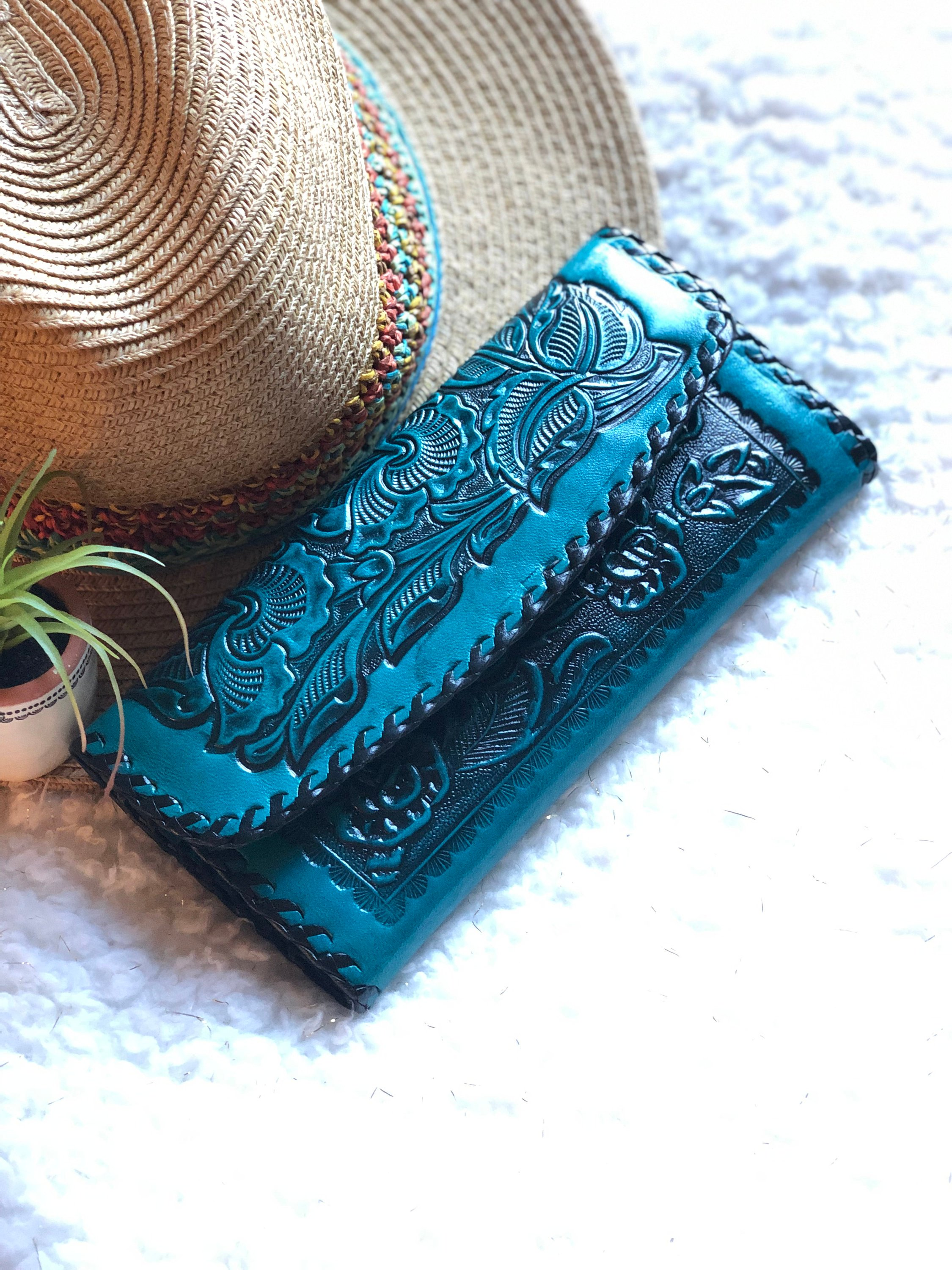 A blue  tooled leather wallet
