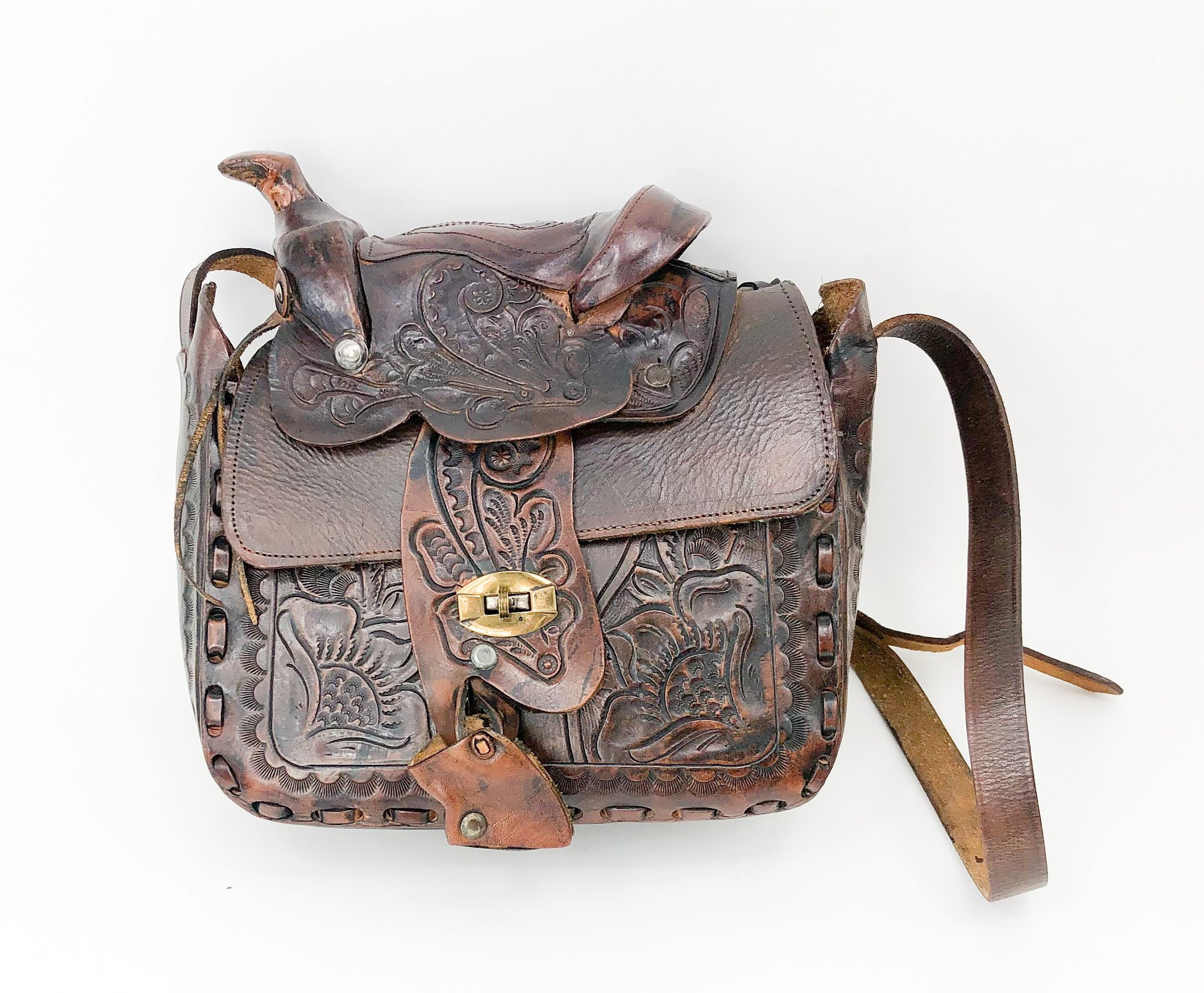 Tooled leather bags  were even made in the shape of saddles!