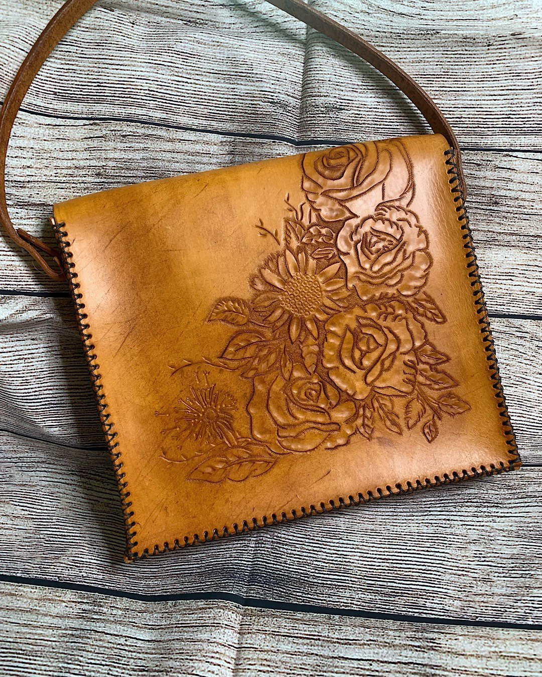 Gorgeous  carved leather handbag  with flowers and stitching around the edges