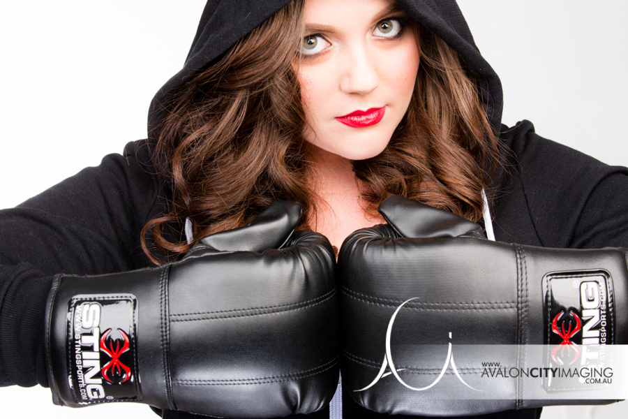 Sometimes it's what you don't show thats sexy!  This badass babe decided on boxing gloves and a hoodie for a deadly photoshoot experience!
