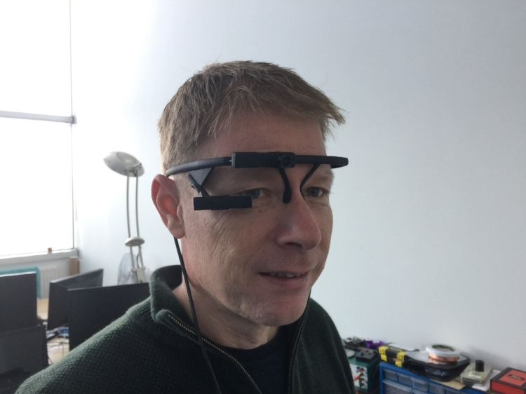 Project manager Simon modelling the Pupil Labs eye tracker