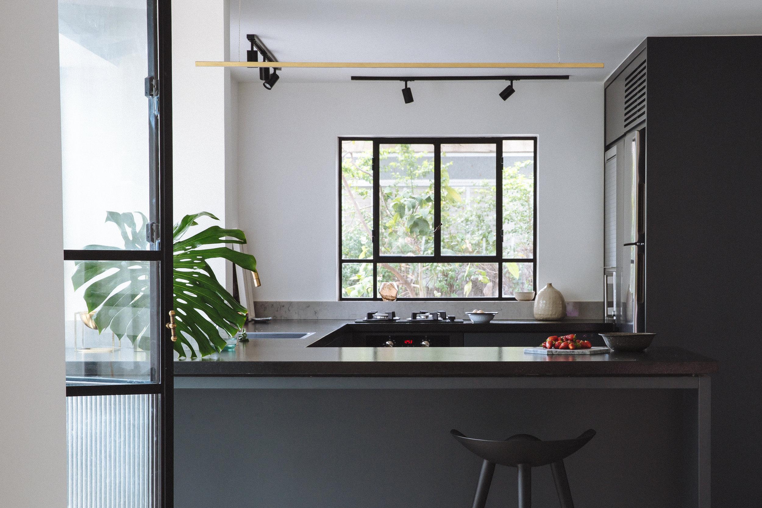 Contemporary kitchen in dark blue and grey. brass details