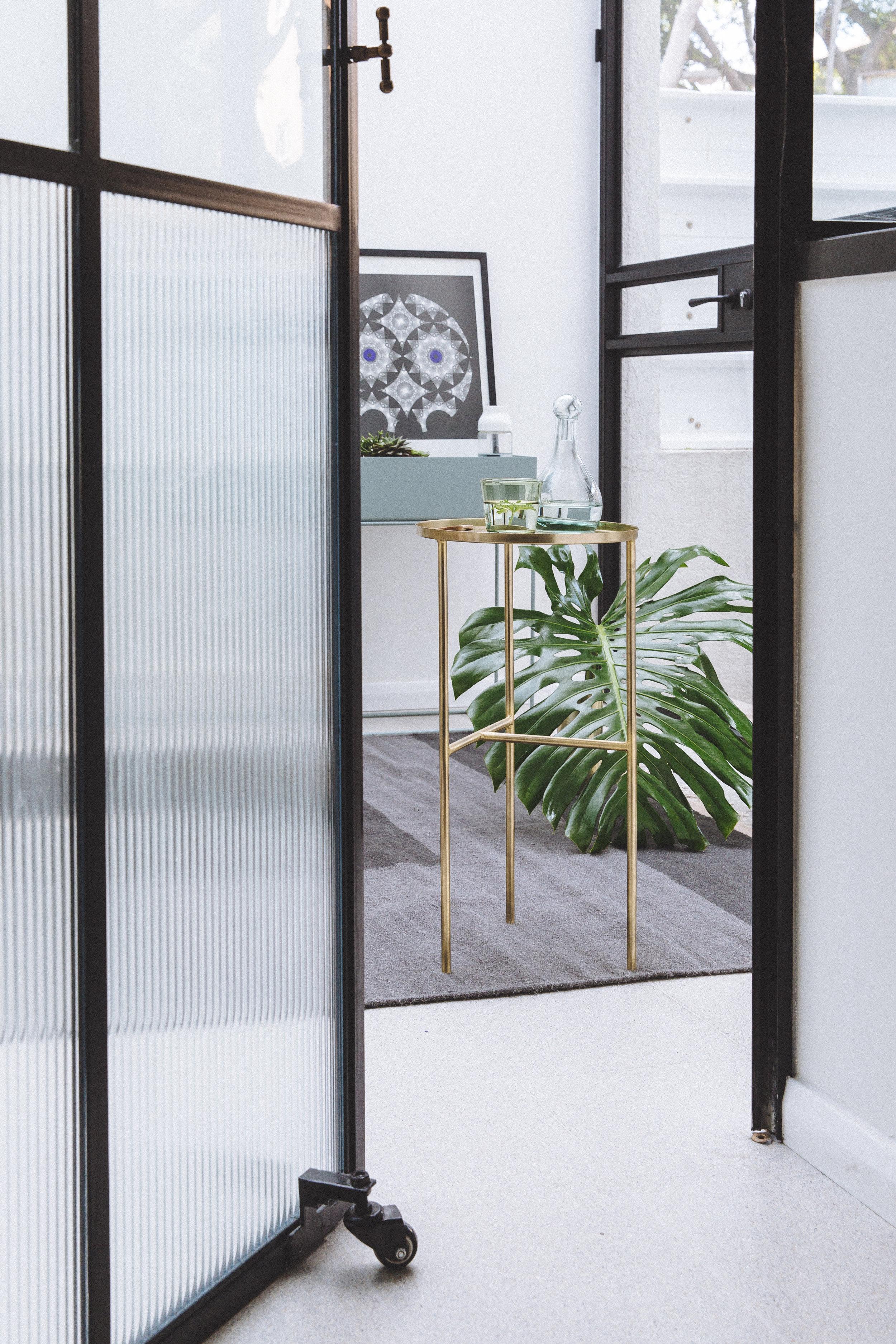 Steel and piped glass door. Terrazzo flooring