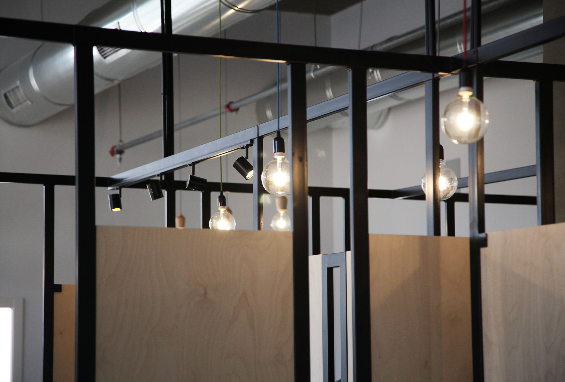 steel construction of wood dividers combined with lighting