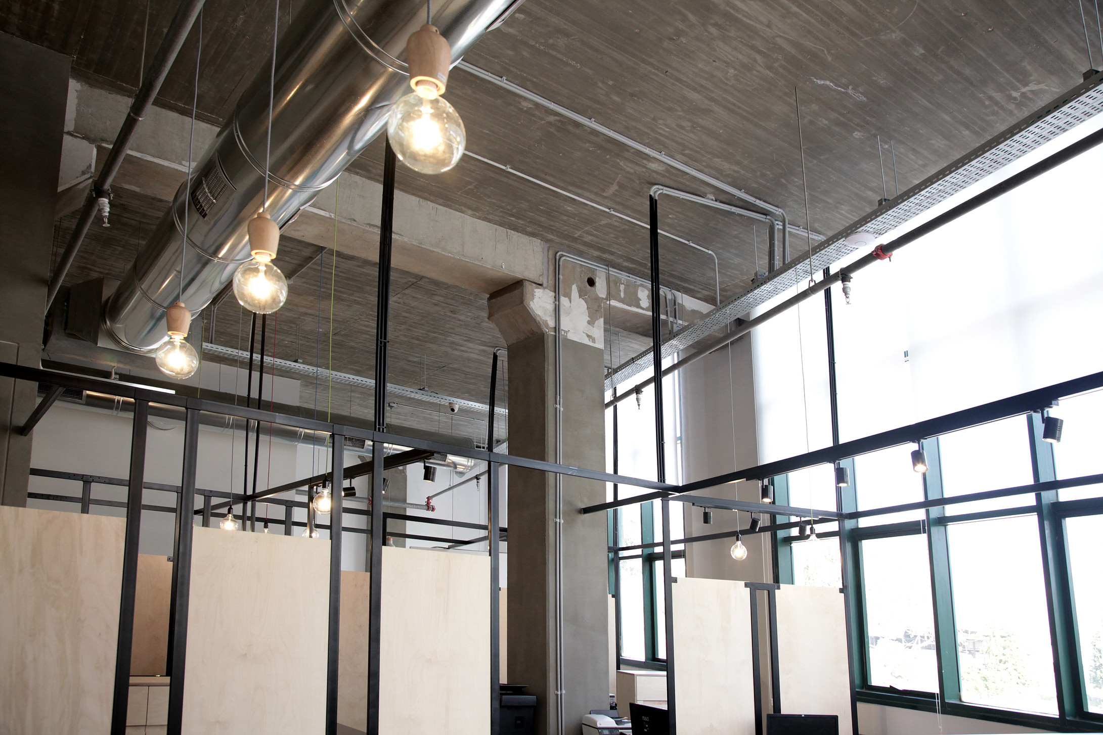 concrete ceiling. grid construction made of steel. wood dividers