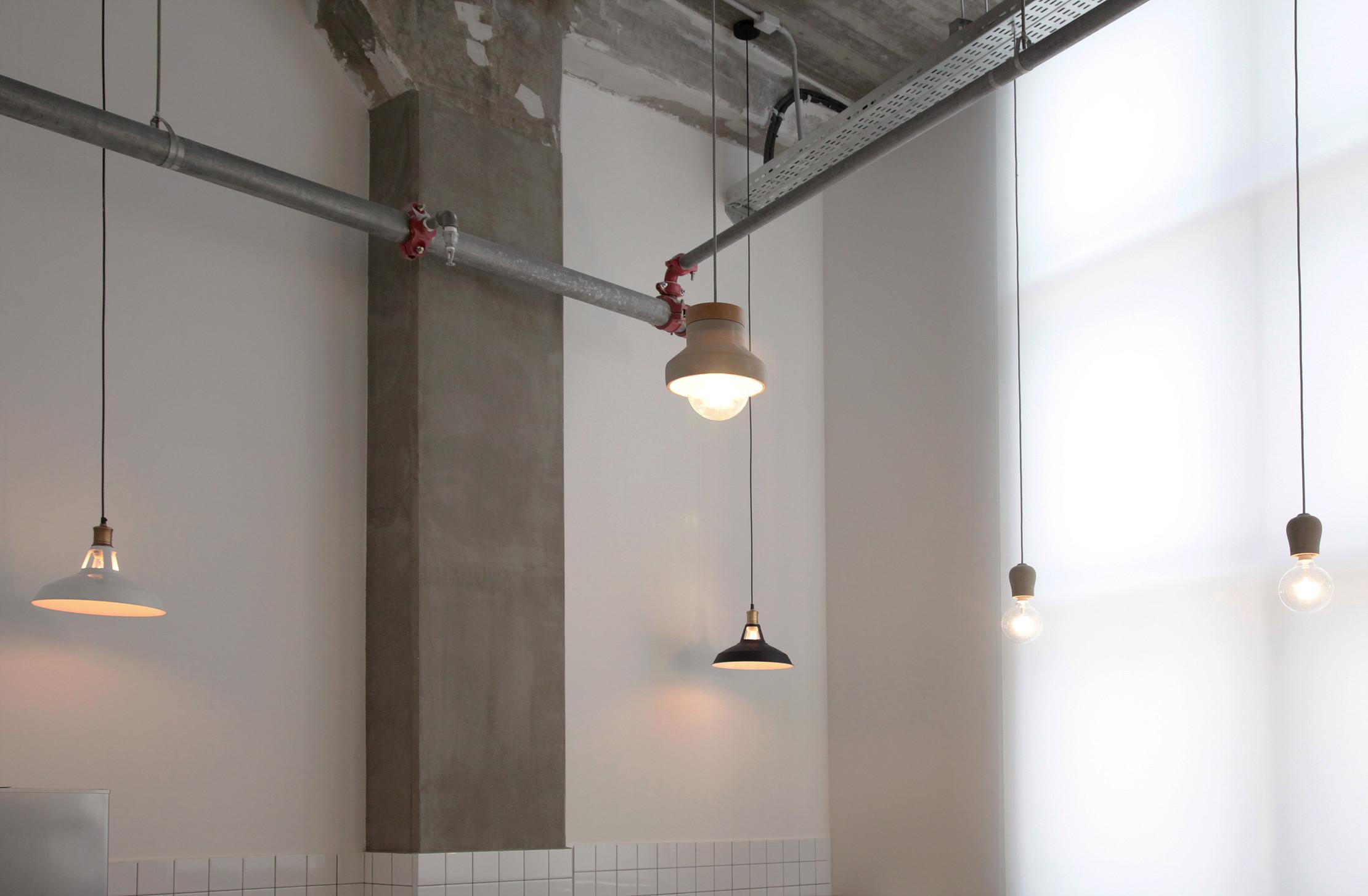 mix lighting. concrete ceiling