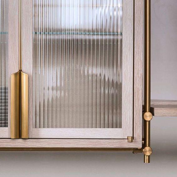 Piped glass door brass details