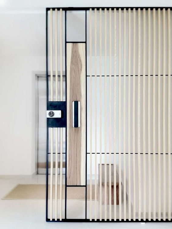Wood louvers on steel and glass door