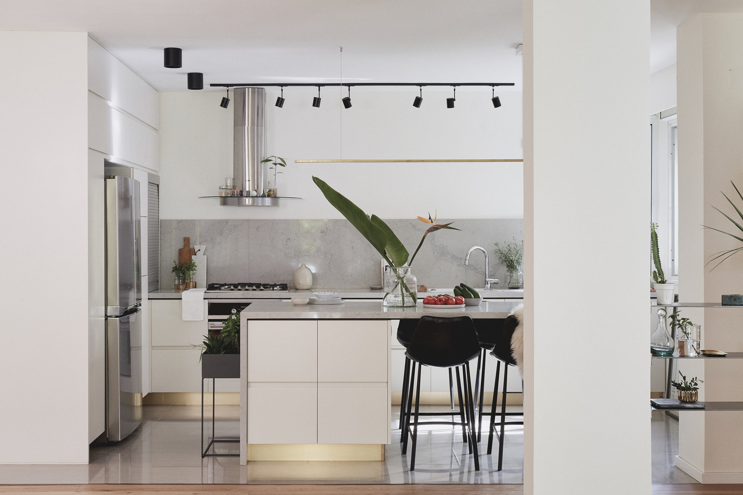 light grey kitchen with brass details