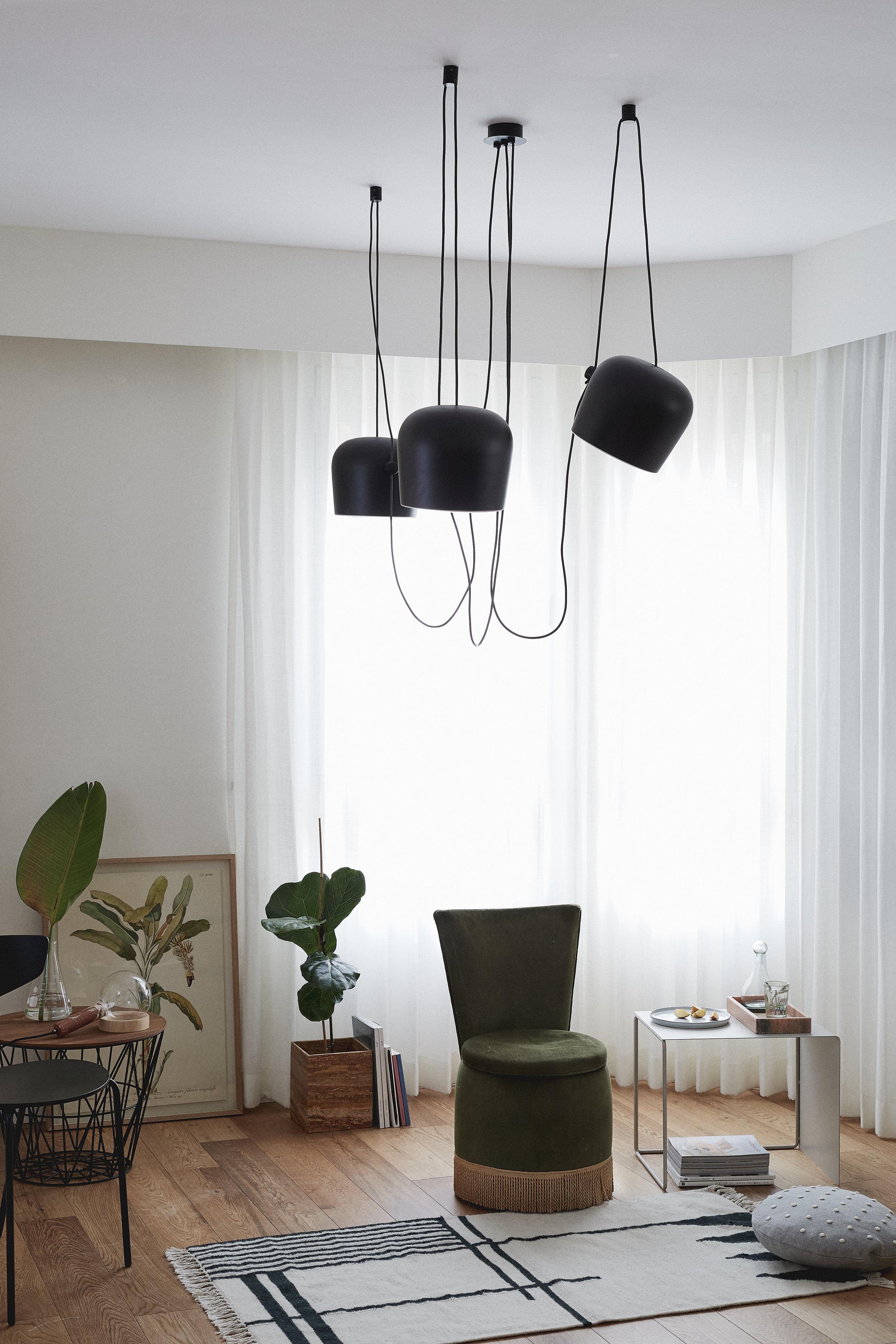Flos lighting. green velvet chair. Ferm Living furniture