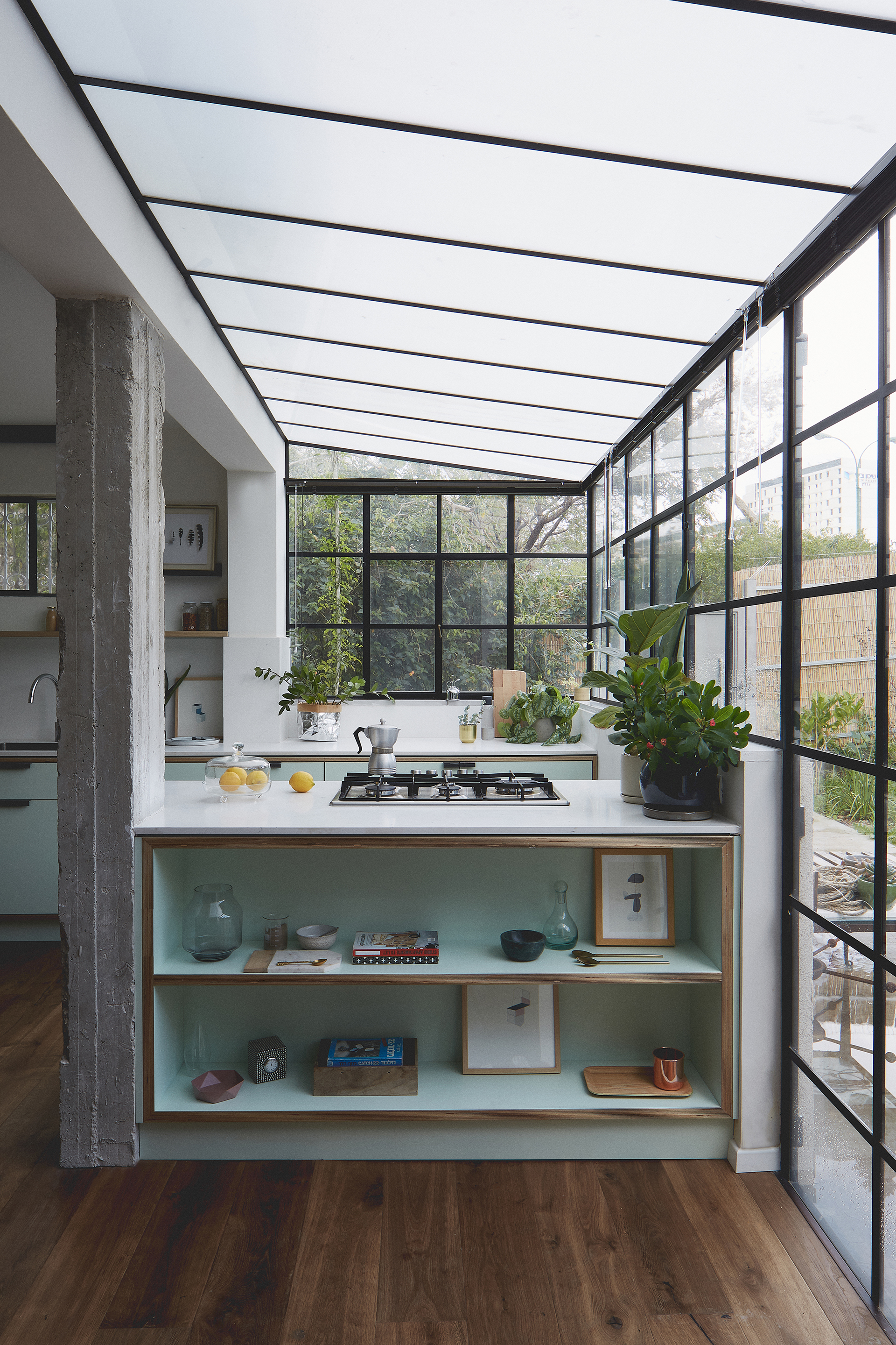 greenhouse-like kitchen in mint green