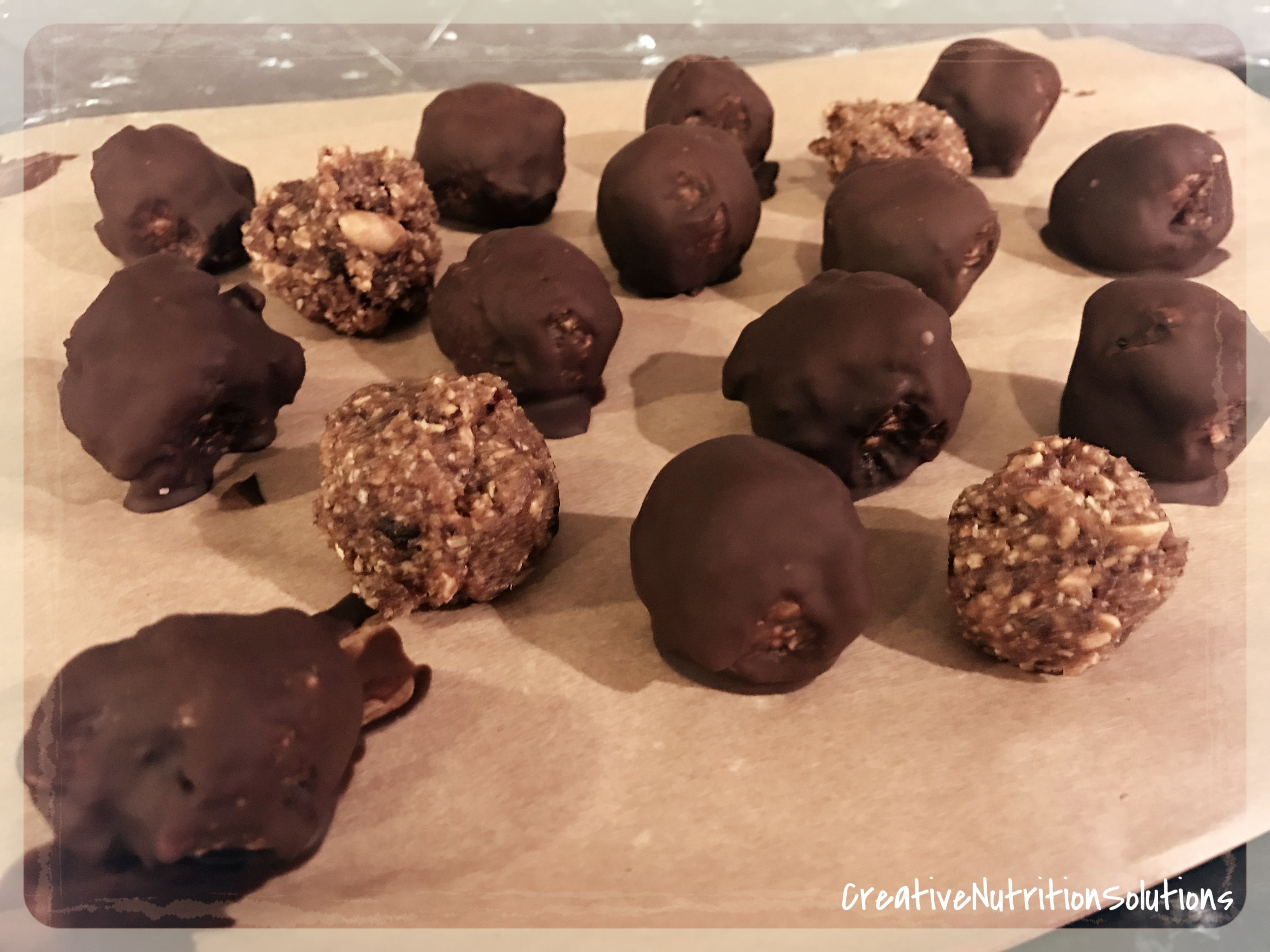 """Roll into 1"""" bites and then dip in melted dark chocolate or skip the chocolate (although they taste really delicious with a thin chocolate coating!). Place on a parchment lined baking sheet and freeze for 1 - 2 hours or until the chocolate is hardened. Then transfer to a air tight container and keep frozen or refrigerated. Although, personally I think that they taste amazing when frozen!"""