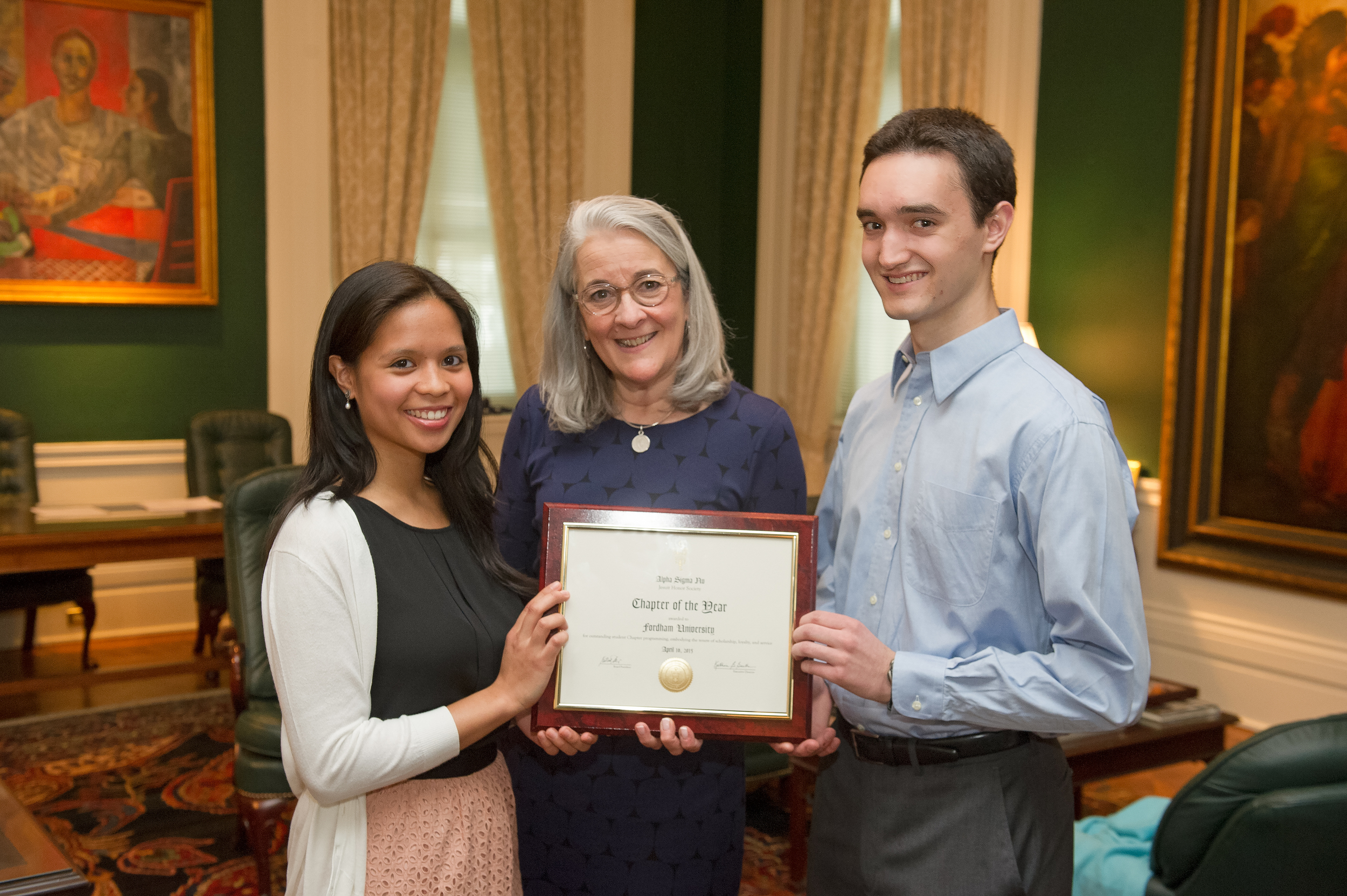 Above: Kate Gaertner, executive director of Alpha Sigma Nu, presents the ASN Chapter award to Rachel Mae Aguilar, the 2014-15 president of the Fordham ASN chapter, and Jeremy Fague, the chapter's incoming 2015-16 president.  Photo by Chris Taggart,Fordham University.