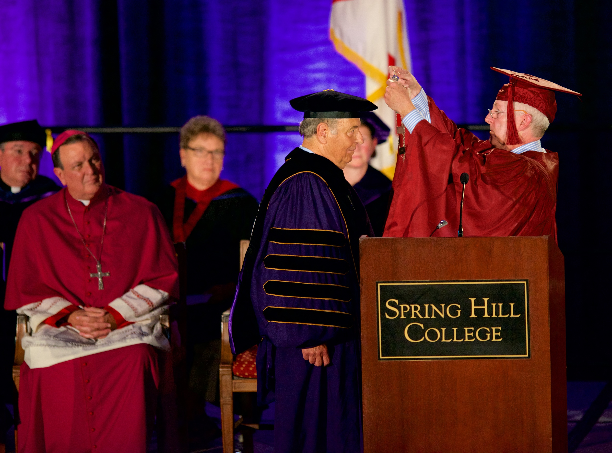 Chairman of the Spring Hill College Board Michael Coghlan presents Dr. Puto with the SHC presidential medallion. Photo by Spring Hill College.