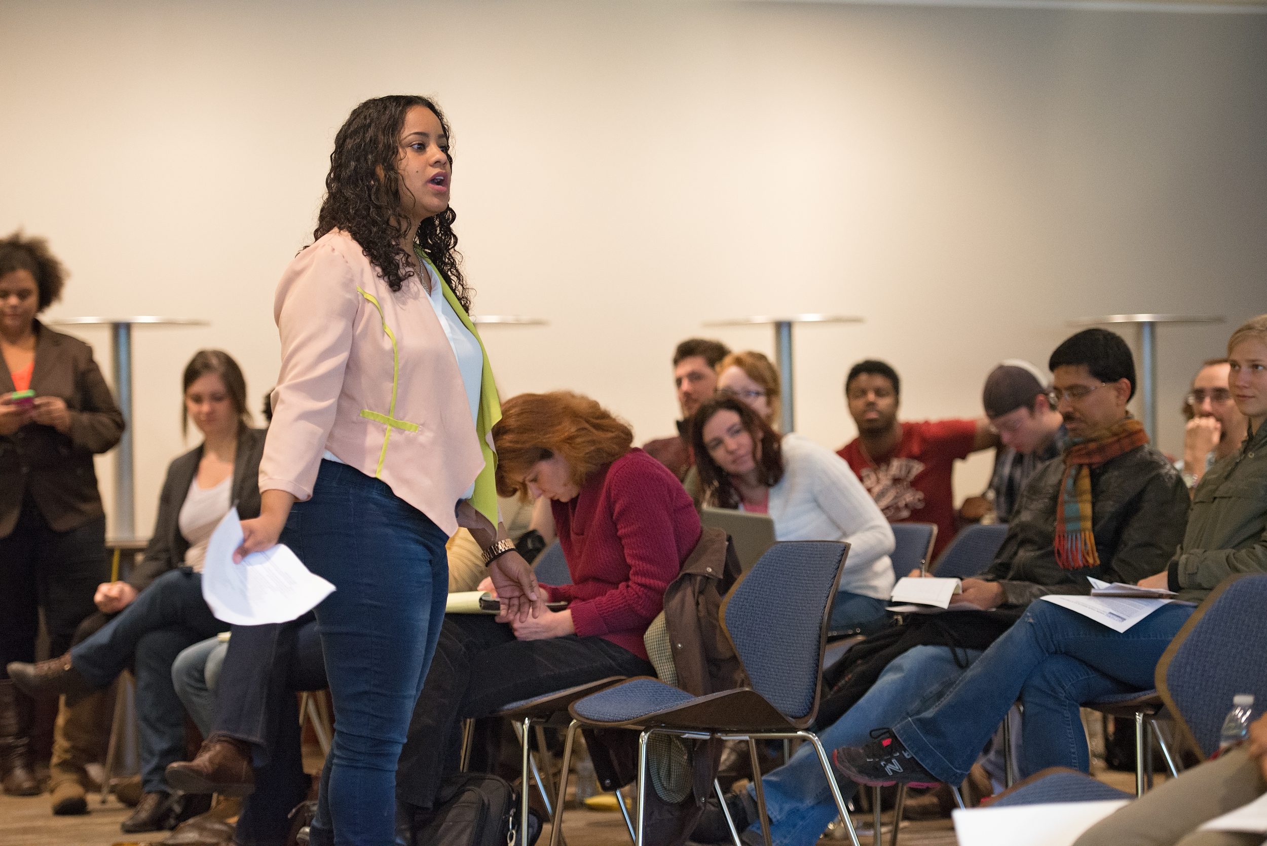 Third-year law student Avvennette Gezahan addresses the crowd at a 'Know Your Rights' workshop in October 2014. (Photo by Saint Louis University)