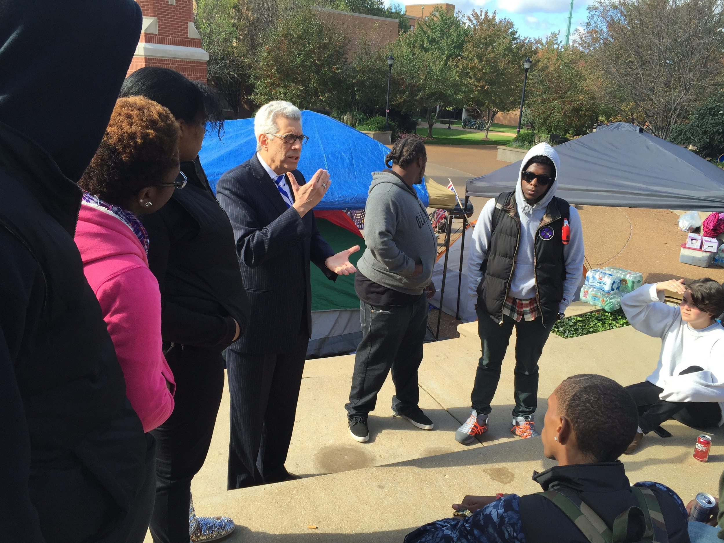 Saint Louis University President Dr. Fred P. Pestello speaks with protesters (Photo by Saint Louis University)