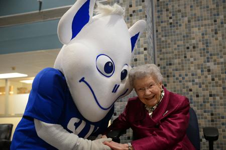 Mary Bruemmer with the SLU Billiken (Photo by Saint Louis University)
