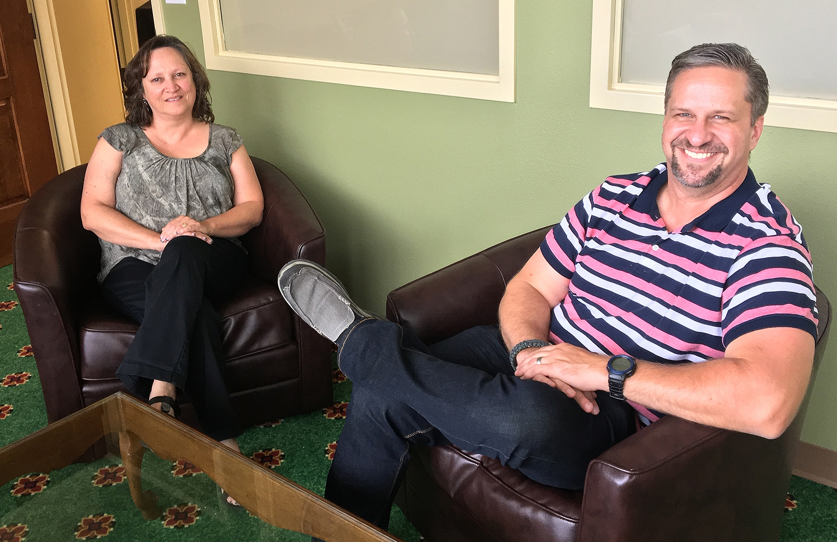 Regis University's Andi Houdek, left, and Josh Kreimeyer sit in a counseling room at the Mt. Carmel Center for Excellence; Regis and Mt. Carmel have partnered together to provide counseling to veterans. (Photo by Regis University)