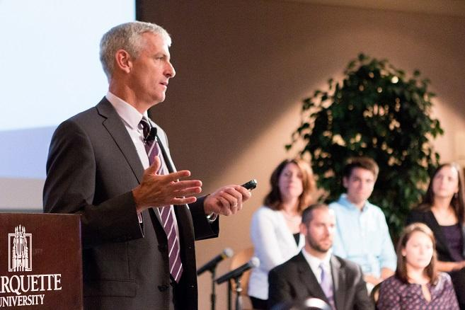 Marquette University President Michael R. Lovell addresses a capacity crowd at a Near West Side Partners community forum. (Photo by marquette University)