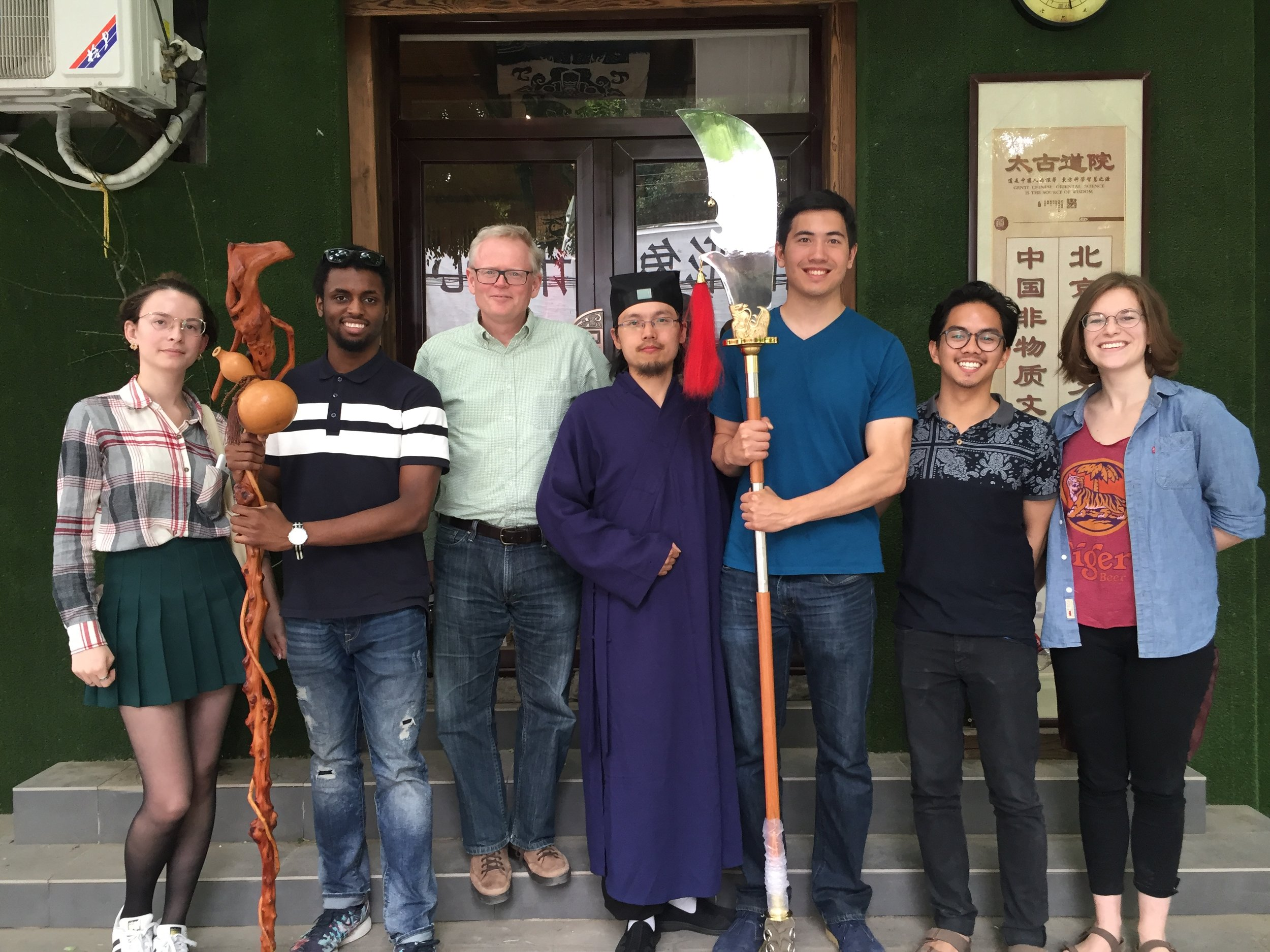 Ian Johnson (third from left) with TBC students at the office of a Daoist priest in China (Photo Courtesy of Dr. Amanda Barry)