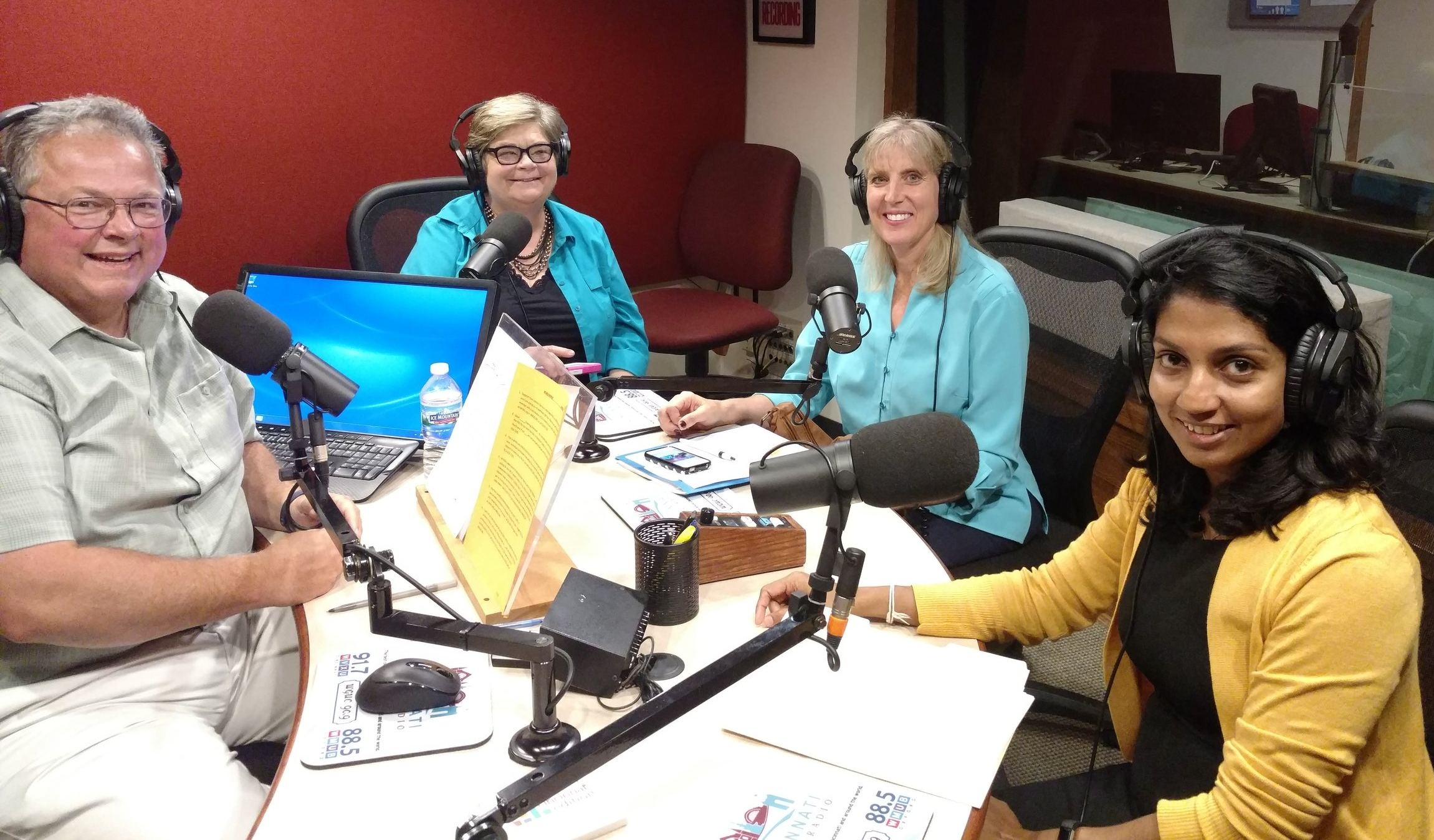 Photo: Dr. Debra Mooney (second from right) joins the WVXU public radio station to present on Xavier's immigration education efforts with the host of  Cincinnati Edition , Mark Heyne, and two grant recipients, Drs. Christine Anderson (second from left) and Thilini Ariyachandra (right) (Photo by Xavier University).