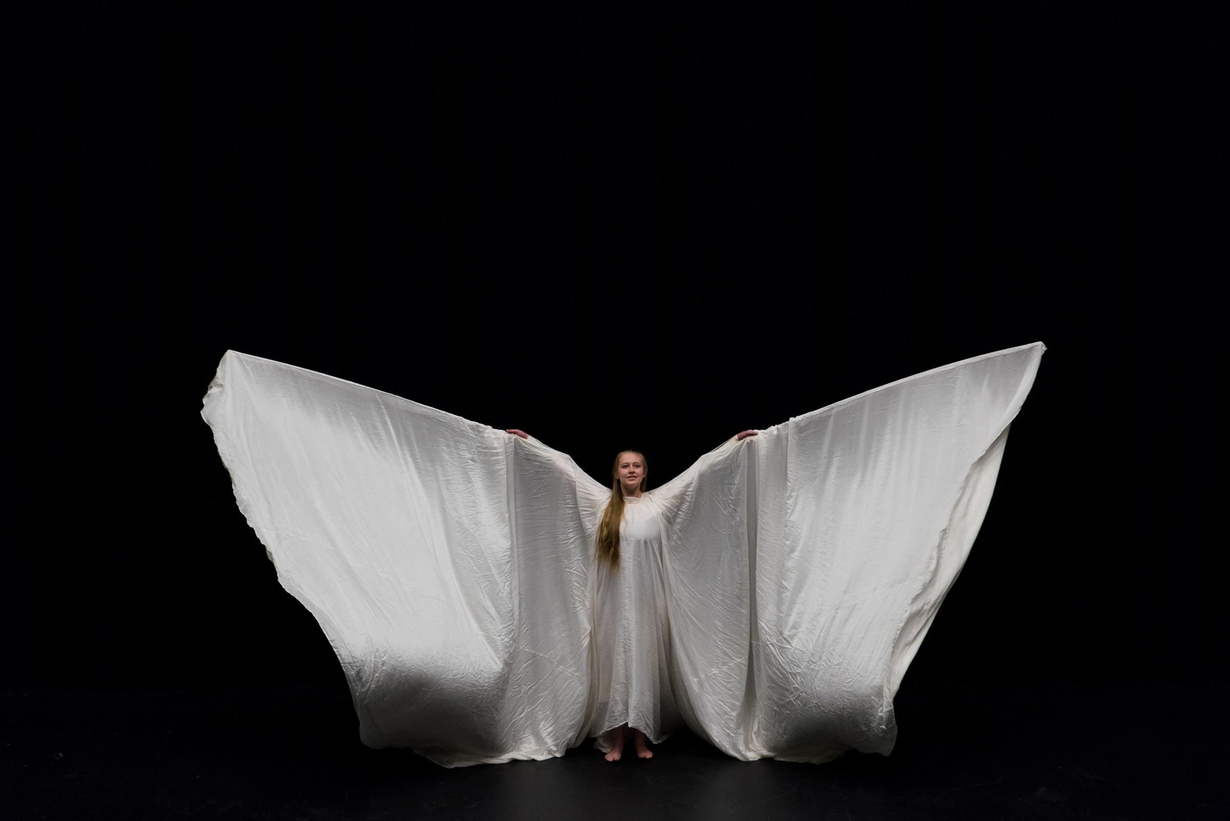Dancer in white: Laura Miller re-created the work of famed American interdisciplinary dance artist Loïe Fuller in a preview of the Spring 2017 Dance Performance at Gonzaga (Photo by Edward Bell)