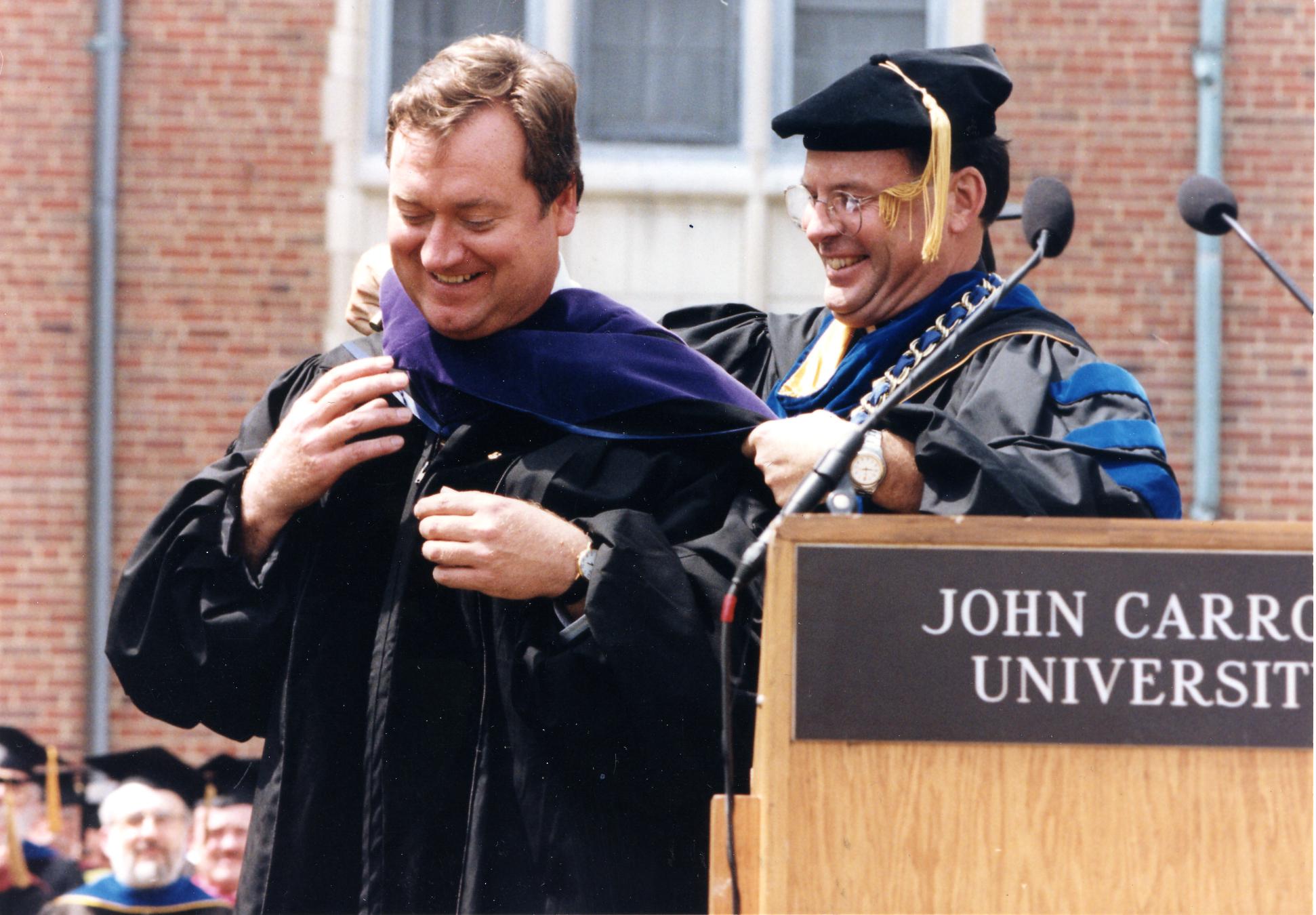 TIM RUSSERT RECEIVING AN HONORARY DEGREE FROM JOHN CARROLL UNIVERSITY IN 1997 (PHOTO BY JOHN CARROLL UNIVERSITY)