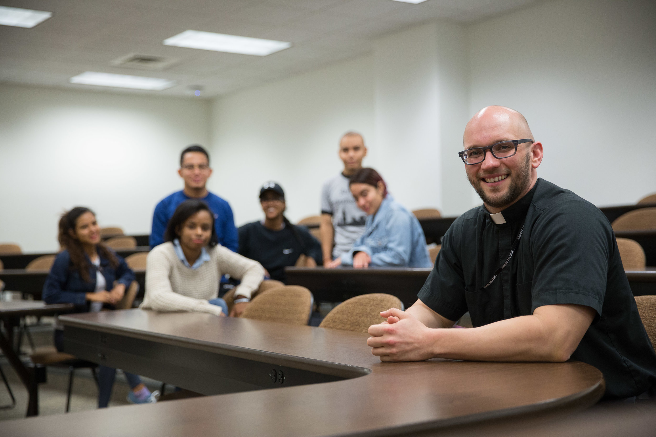 Eric Immel, S.J., with members of the student government at Arrupe College in Chicago, IL (photo by Midwest Jesuits)