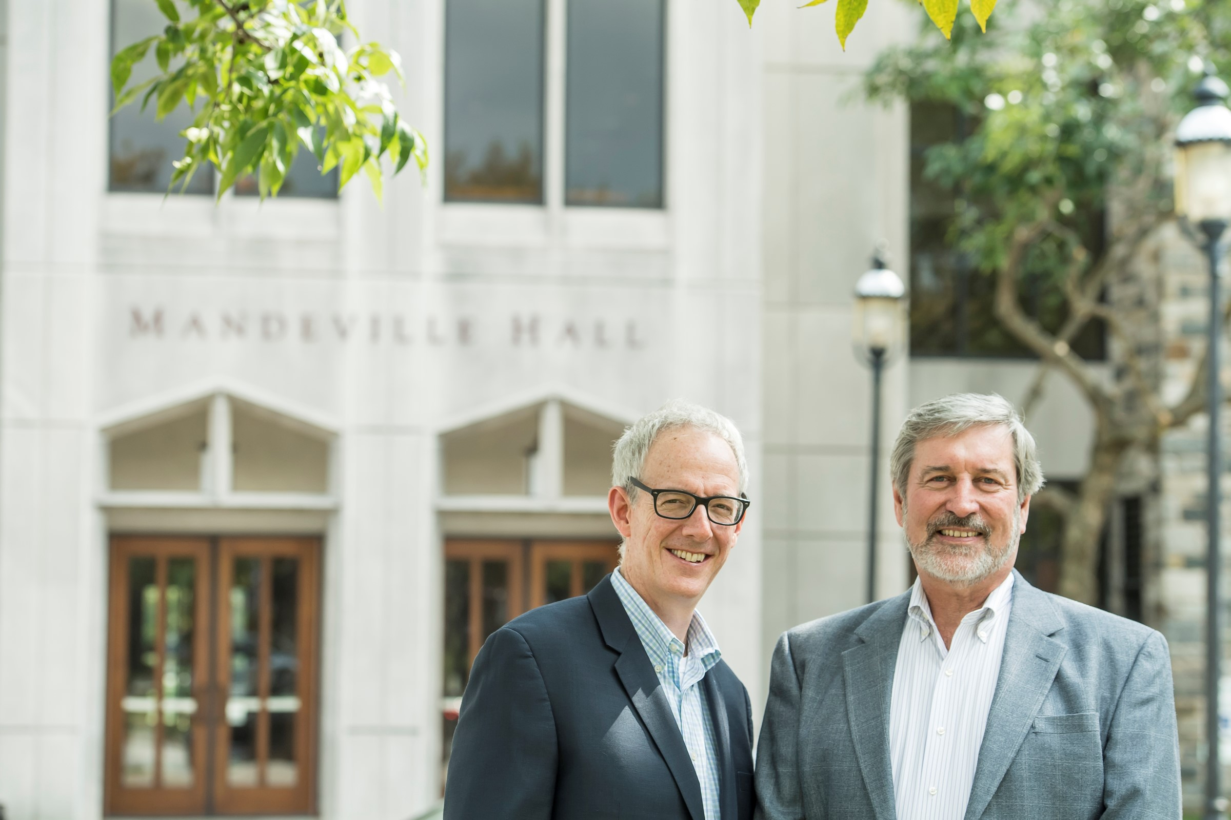 David Steingard, Ph.D., (left) and John McCall, Ph.D. in front of the Haub School of Business' Mandeville Hall (Photo by Saint Joseph's University)