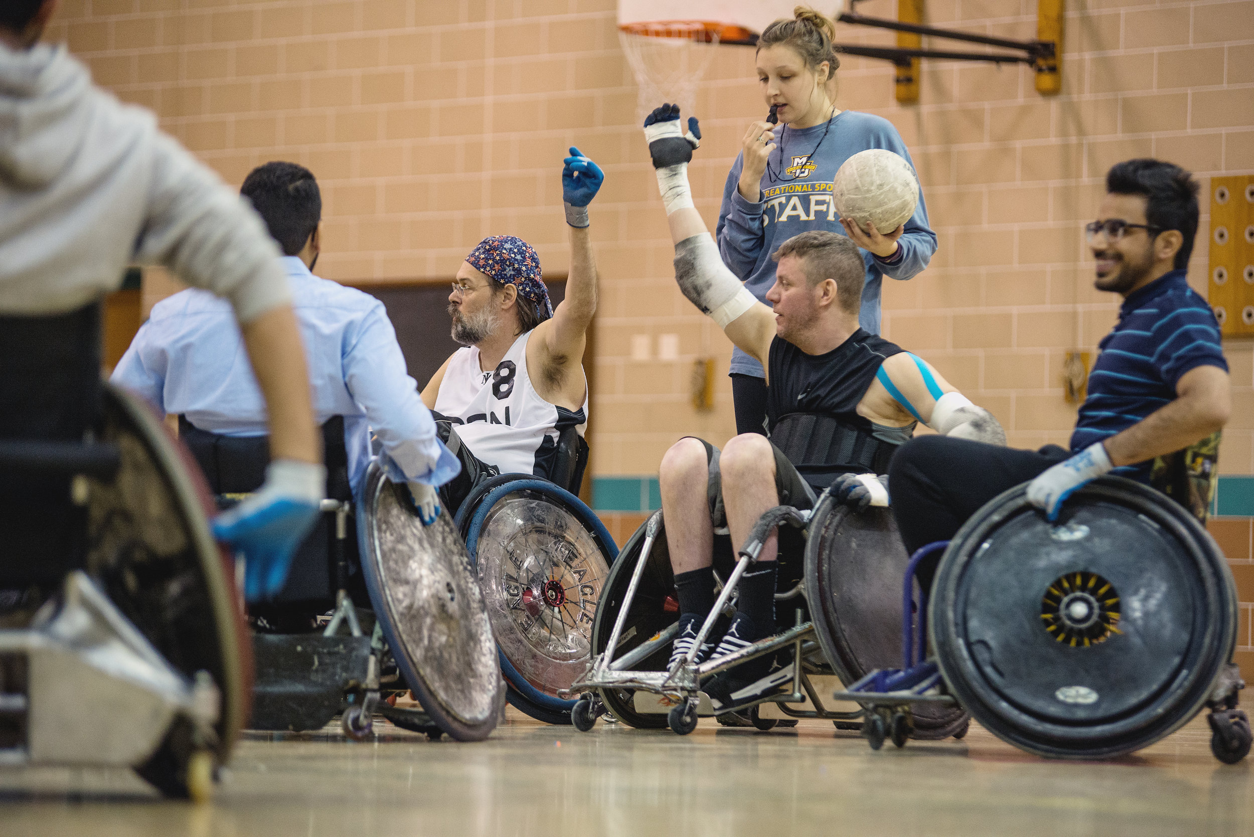 Members of the Milwaukee Iron wheelchair rugby team scrimmage with students (Photo by Marquette University)