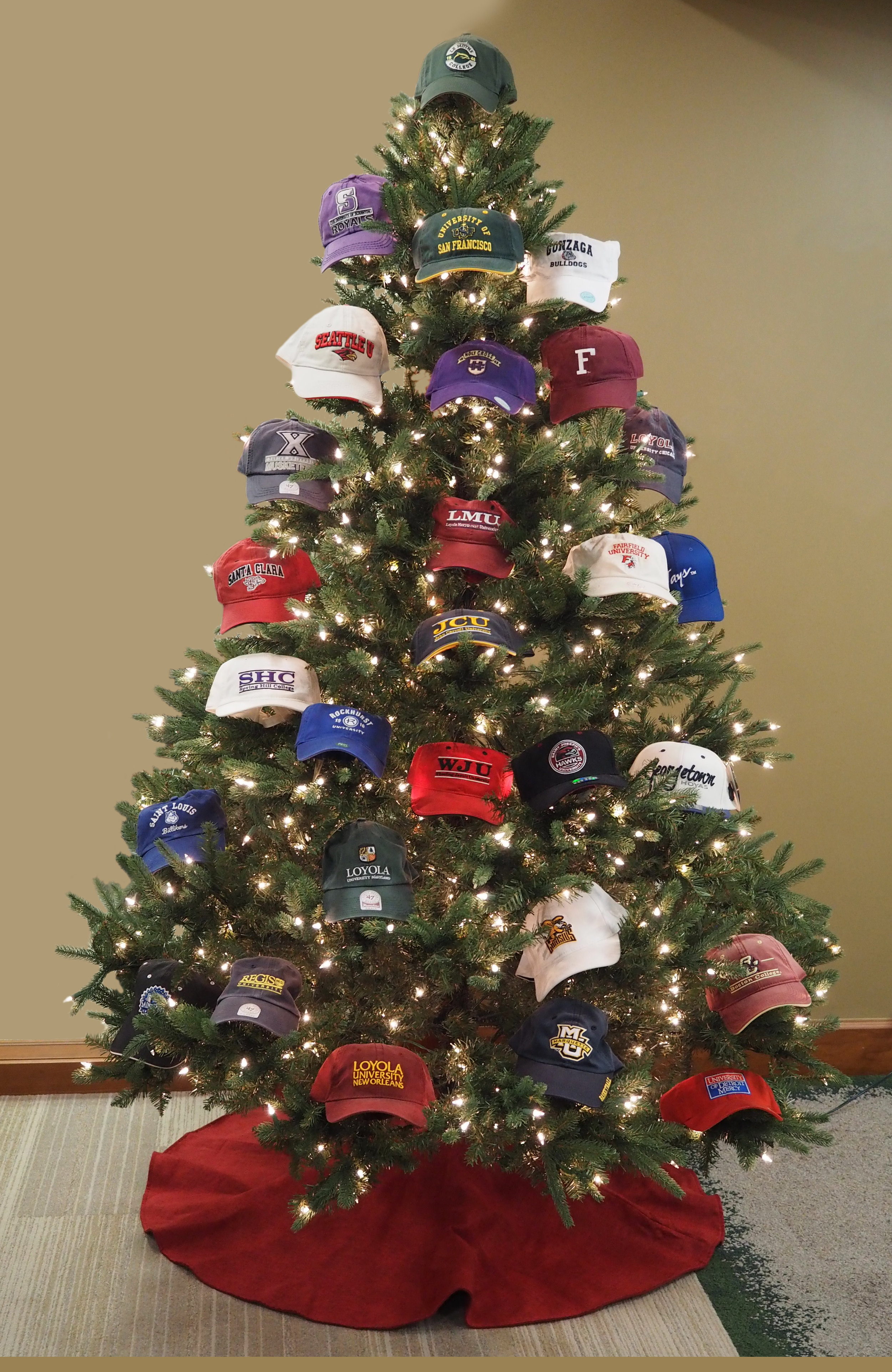 Le Moyne College's Christmas tree features hats from all 28 U.S. Jesuit colleges and universities (photo by Le Moyne College)