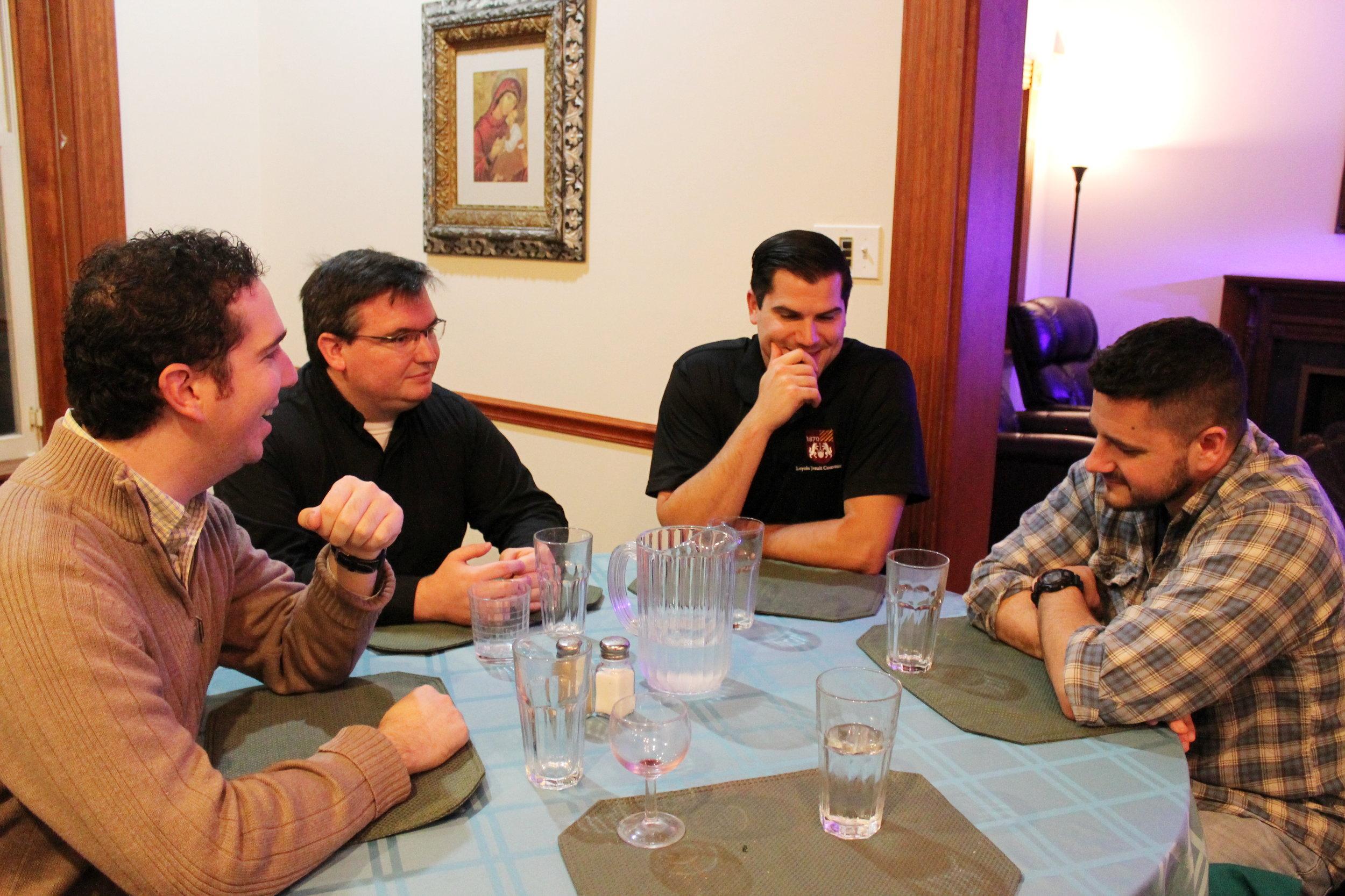 Jesuit scholastics enjoy dinner together at Bellarmine House (photo courtesy of Saint Louis University)