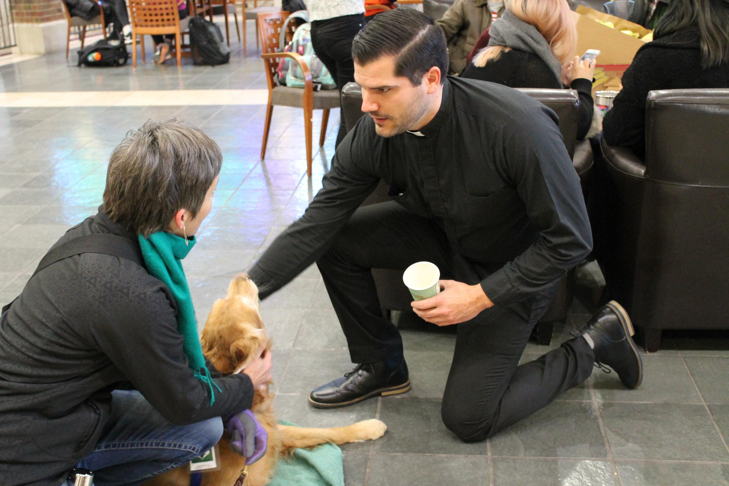A young Jesuit on campus at Saint Louis University (photo by Saint Louis University)