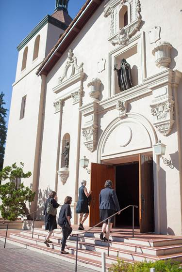 """At Santa Clara's Mission Church, students notice that they must literally """"step up"""" to participate, and that the cool and dim interior is an invitation to calm (photo by Joanne Lee, courtesy of Santa Clara University)"""