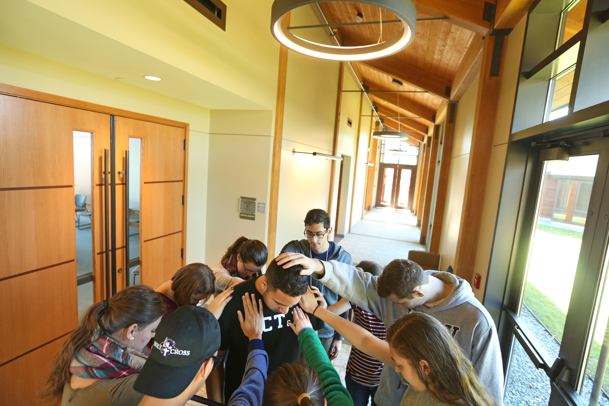 Students pray inside of the Contemplative Center (photo by Tom Retigg for the College of the Holy Cross)