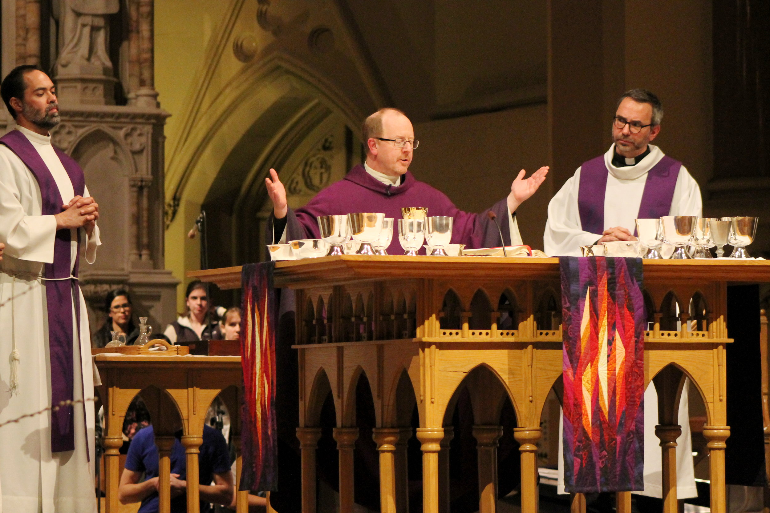 Jesuit priests say the Eucharistic Prayer at the 9 PM College Church Mass (photo by Molly Daily for Saint Louis University)