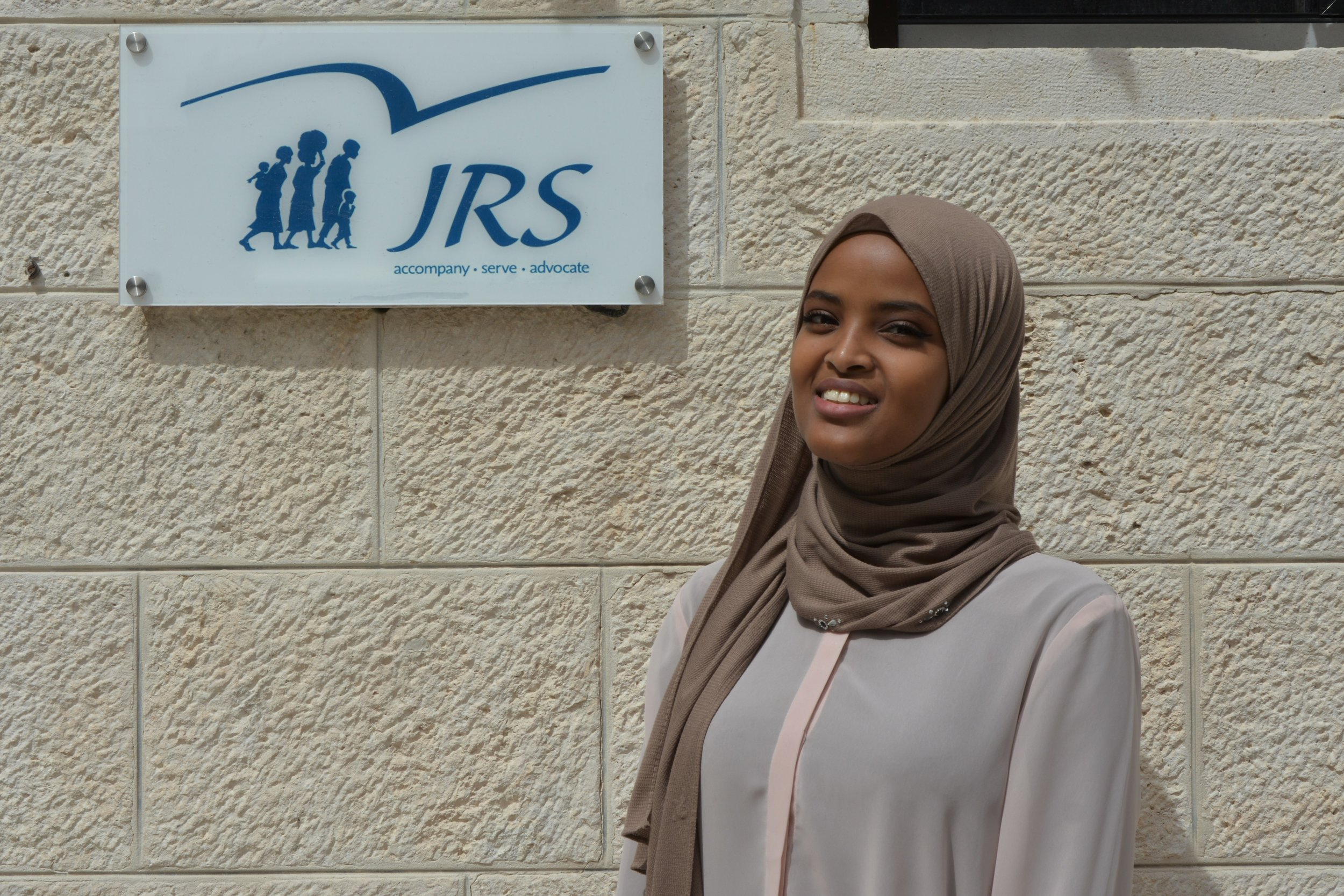 Fowzia, originally from Somalia, is a former student in a JRS camp who now volunteers as an English teacher (photo by JRS International)