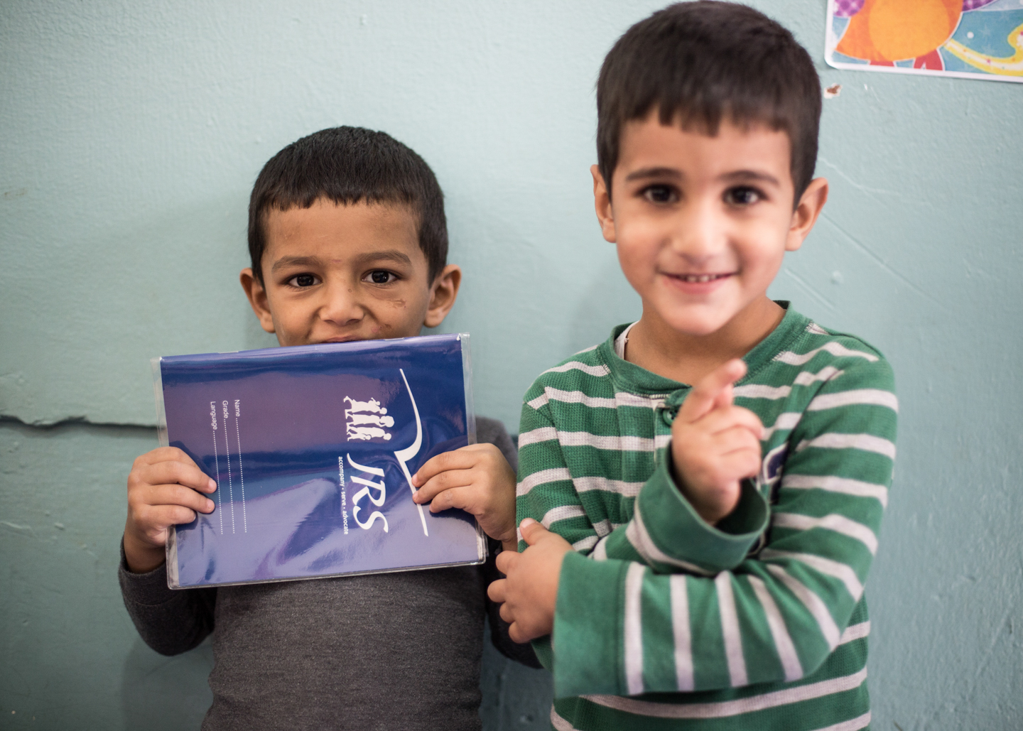 Two smiling students at the Frans van der Lugt Centre in Bourj Hammoud, Lebanon (photo by JRS International)