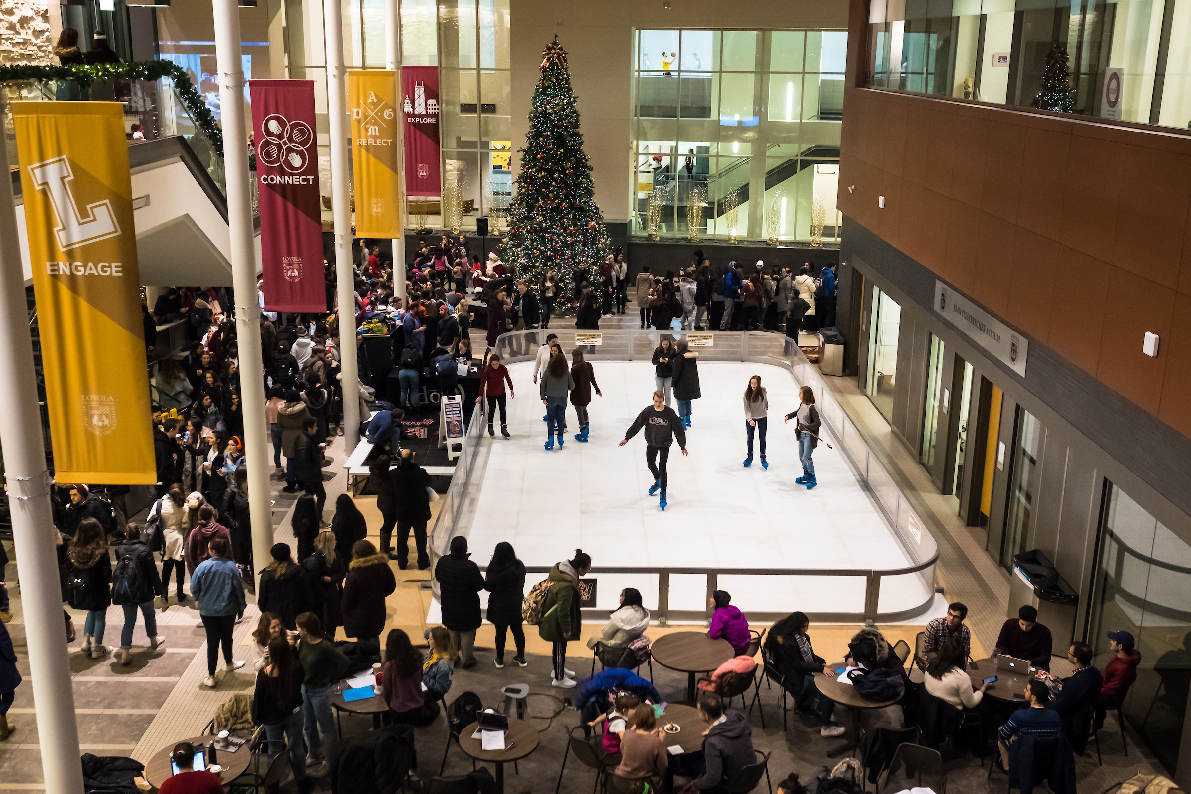 Loyola University Chicago students skate around on an indoor ice skating rink during the annual Christmas Tree Lighting Ceremony in the Damen Student Center on November 29 (Photo by Lukas Keapproth;   click here for more photos of Loyola at Christmas  )