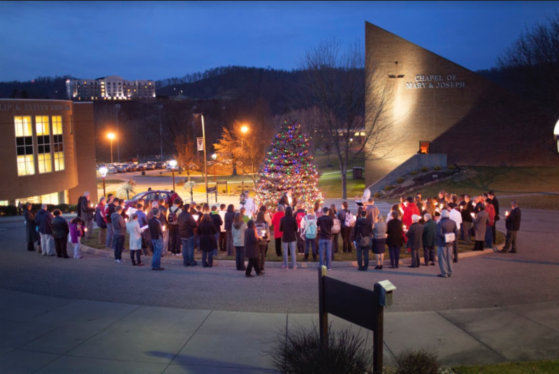 Students gathered in front of the campus chapel for this month's Christmas tree lighting ceremony at Wheeling Jesuit University (photo by Wheeling Jesuit University)