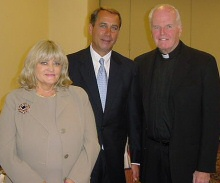 Cyndy with former U.S. Speaker of the House, John Boehner, and former AJCU president, Rev. Charles L. Currie, S.J. (c. 2000s)