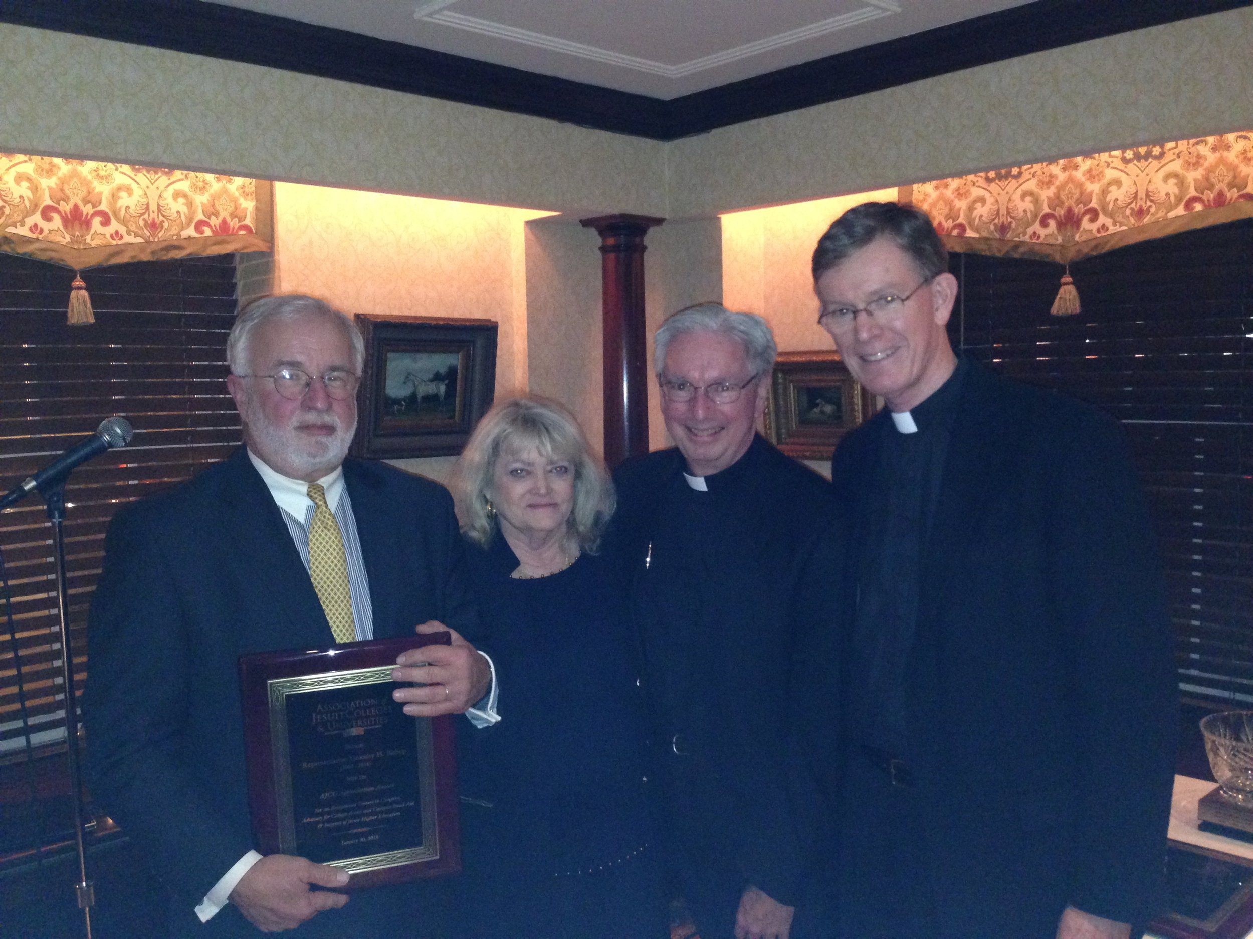 Cyndy with former Representative Tim Bishop, AJCU president, Rev. Michael J. Sheeran, S.J. and College of the Holy Cross president, Rev. Philip Boroughs, S.J., during the Winter 2015 AJCU Board Dinner